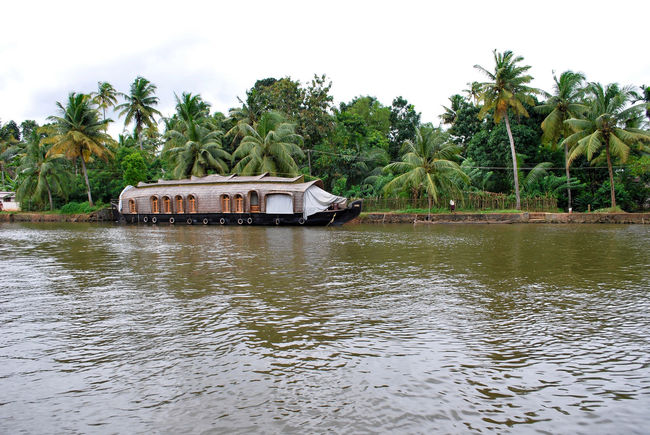 Beauty In Nature Boat Coconut Trees Day Floating Floating On Water Green House Boat Lake Lake View Nature No People Non-urban Scene Outdoors Palm Trees Rippled Scenics Sky Tranquil Scene Tranquility Tree Tree Water Water Reflections Waterfront