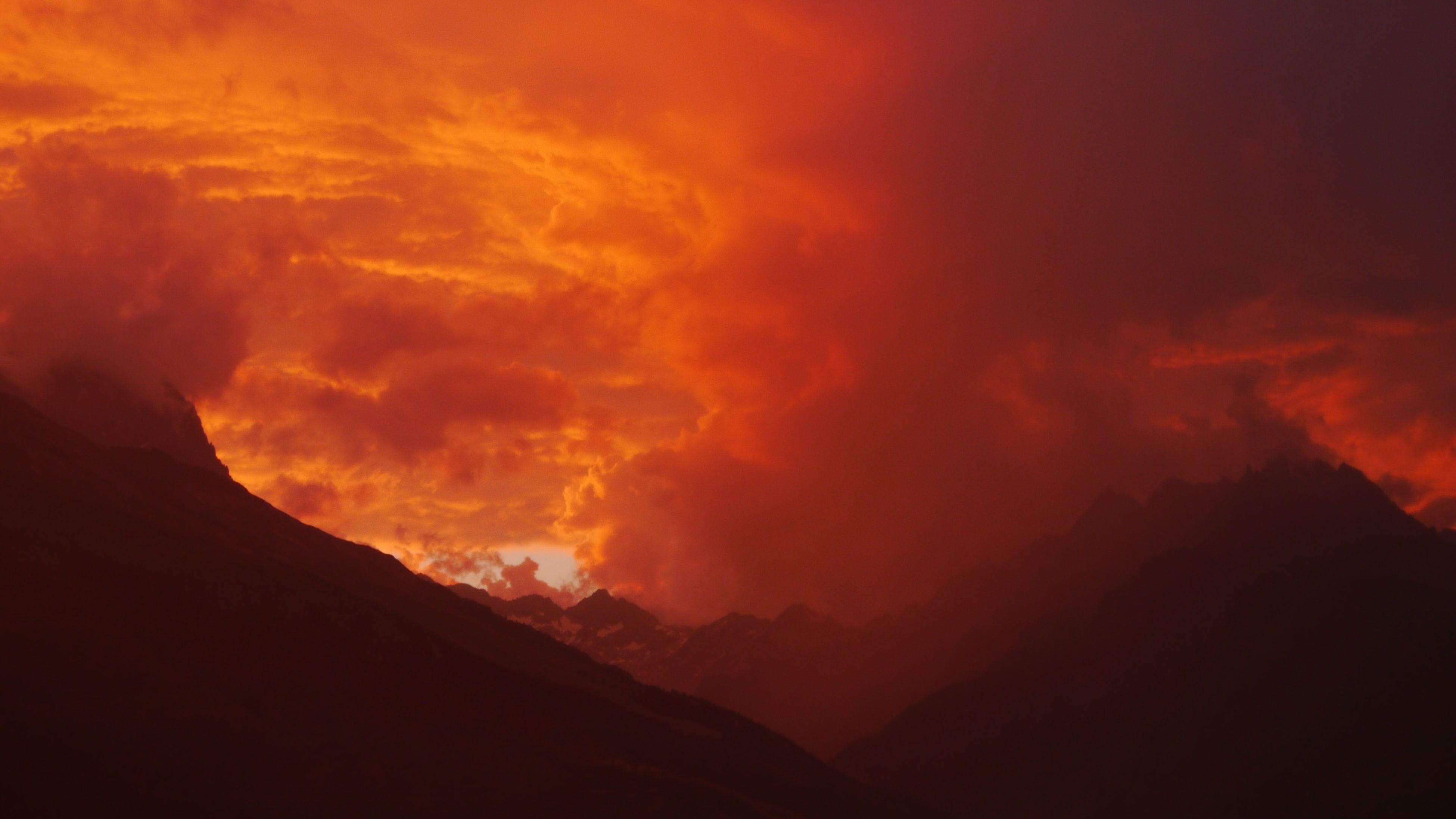 sunset, scenics, tranquil scene, beauty in nature, mountain, tranquility, sky, orange color, silhouette, cloud - sky, idyllic, nature, mountain range, dramatic sky, majestic, landscape, cloud, weather, non-urban scene, cloudy
