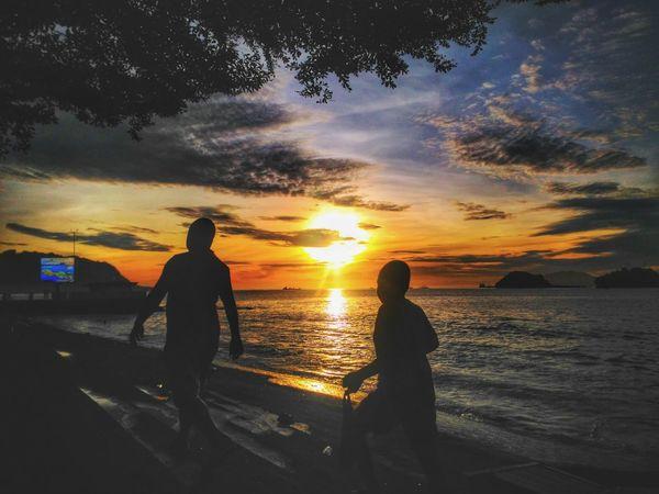 Silhouette Beach Reflection Cloud - Sky Water Two People Sea Sunrise Silhouette Golden Hour Papua Jayapura INDONESIA