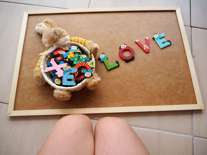 Multi Colored EyeEmNewHere Art Is Everywhere Wood Basket Basket Wood Pieces Wood Toy Letter Box Letters Directly Above Wood Letters Colored Letters The Word Love Love Word Word Art Human Knee Sitting Down Bunny Toy Easter Easter Basket  Neon Life Imagination Creativity Breathing Space Be. Ready.