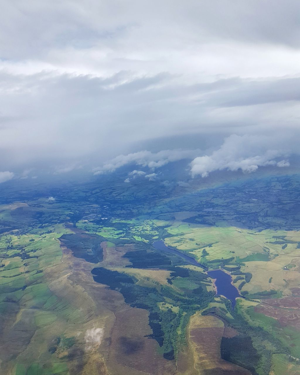 aerial view, scenics, landscape, beauty in nature, agriculture, tranquil scene, nature, cloud - sky, tranquility, rural scene, outdoors, no people, patchwork landscape, day, sky, travel destinations, view into land