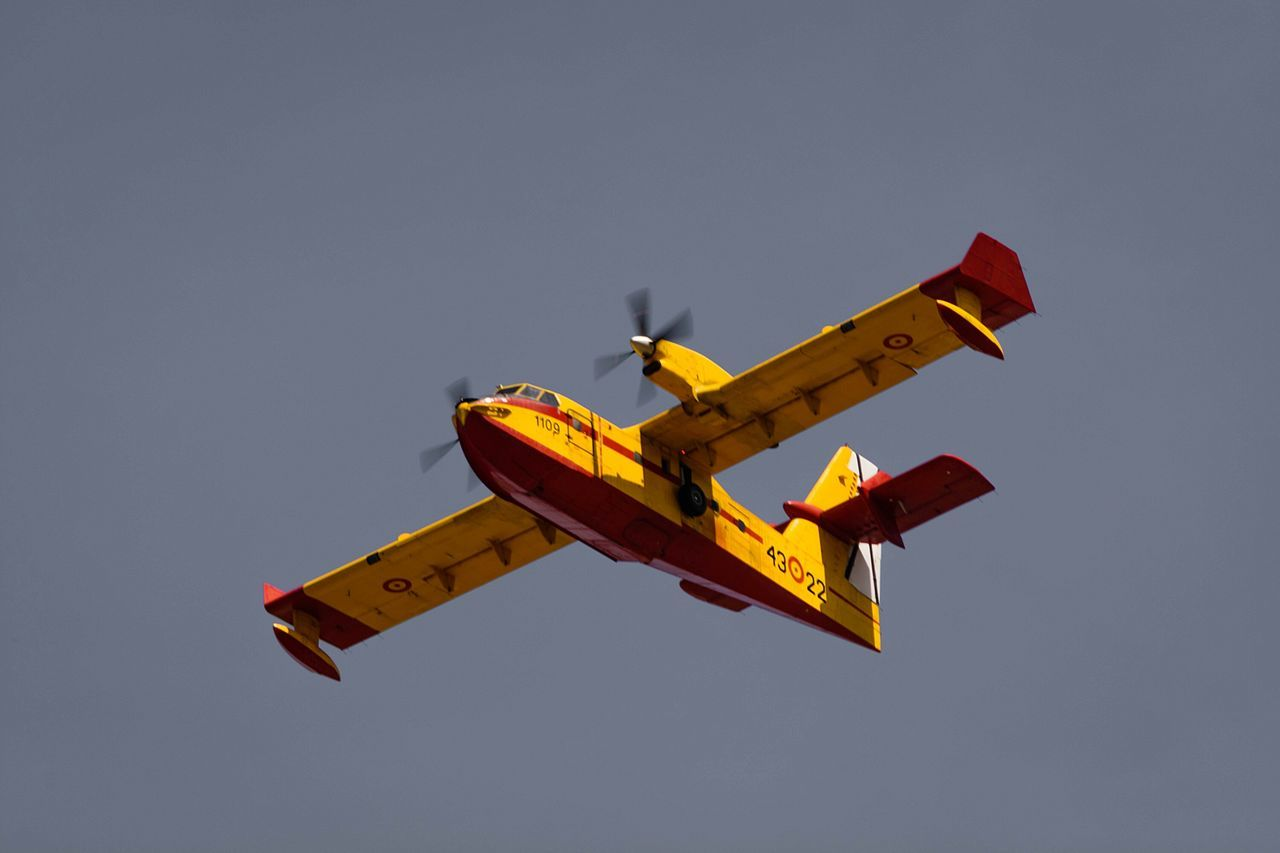 Flying Firefighter Air Vehicle Airplane Airshow Military Outdoors Sky Day Aerobatics People