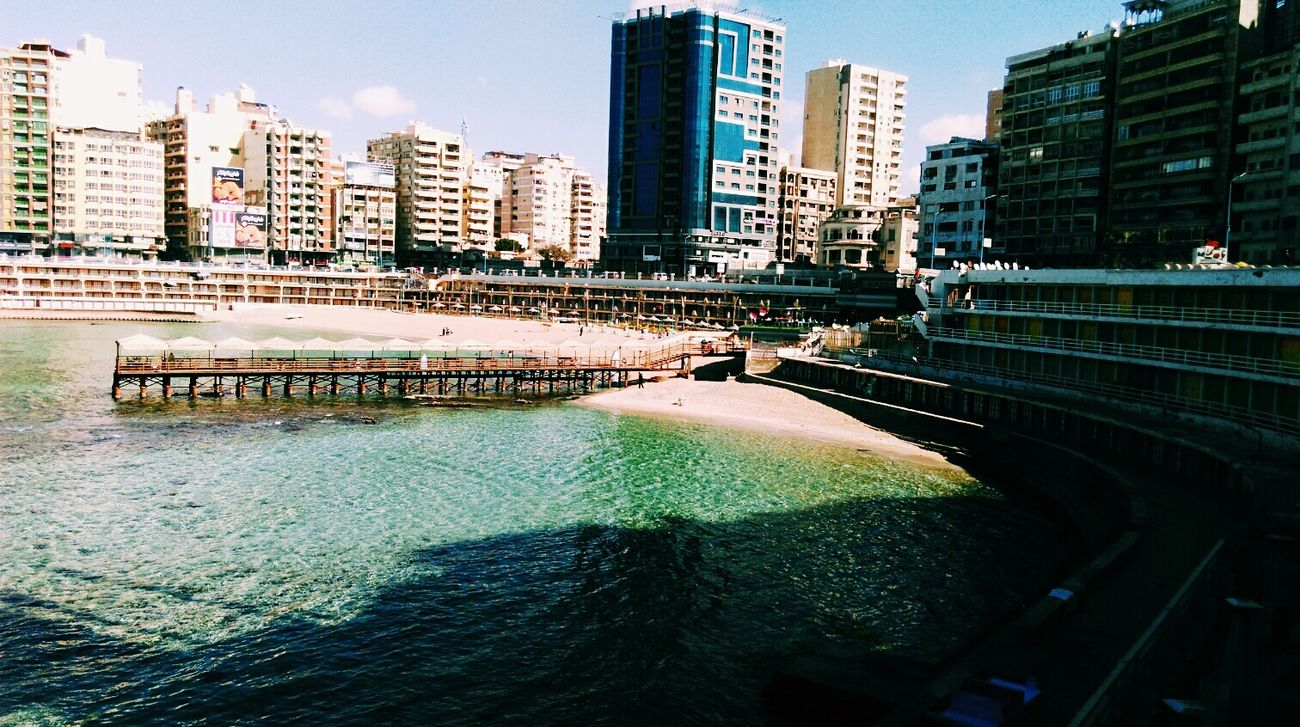 Alexandria Egypt Alexandria Egypt Reflection Water Cityscape Sky Shades Of Nature Blue Vs Green This Is Egypt Wonderful Wanderlust Love Of Nature Sea Stanley Bridge Stanleybeach Alexandria, Egypt Eyeemphotography Carnival Crowds And Details