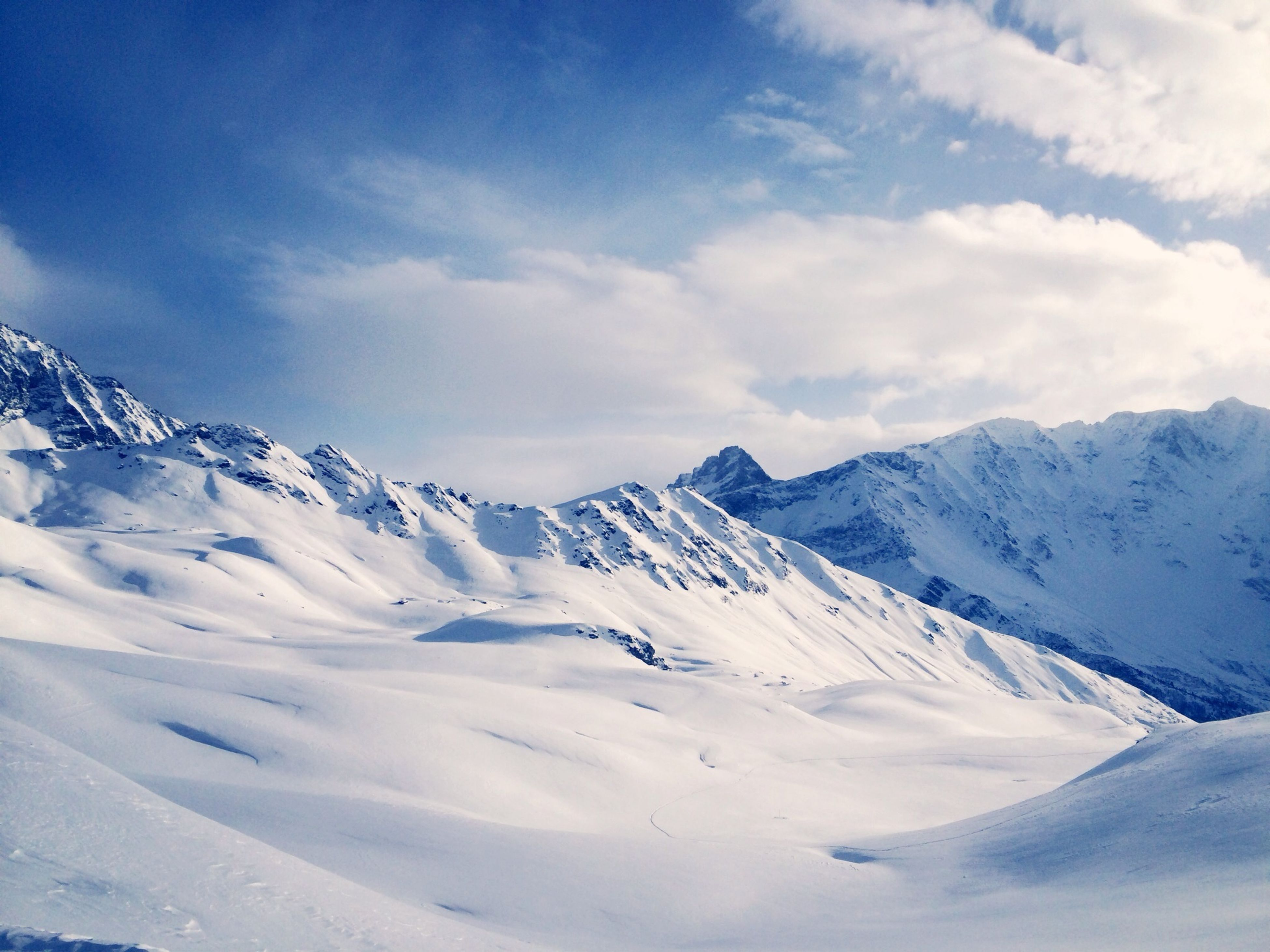 snow, winter, cold temperature, mountain, season, snowcapped mountain, weather, mountain range, tranquil scene, scenics, tranquility, beauty in nature, covering, sky, landscape, nature, white color, cloud - sky, frozen, majestic