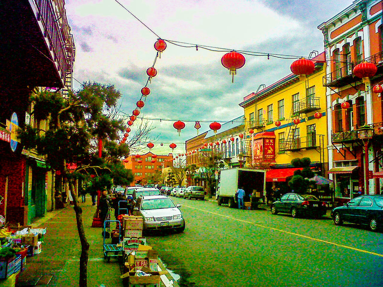 Chinese Lanterns Hanging Over City Street Against Sky