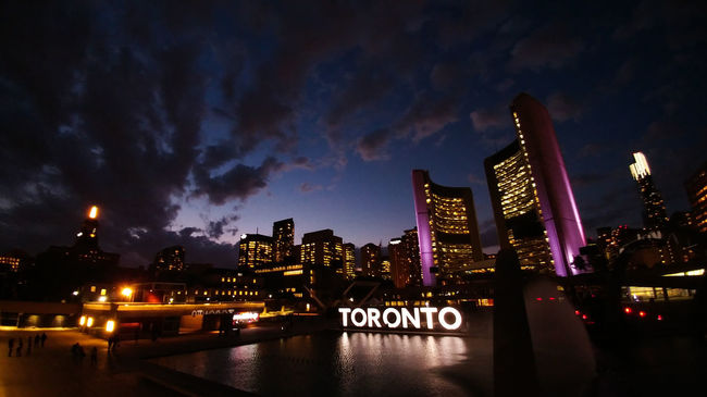 Toronto Torontophotographer Toronto Landscape Illuminated Water Architecture Night Built Structure Building Exterior City Sky Skyscraper Reflection Modern Tall Waterfront Urban Skyline Outdoors Skyline Office Building Downtown District Financial District  Sea Battle Of The Cities