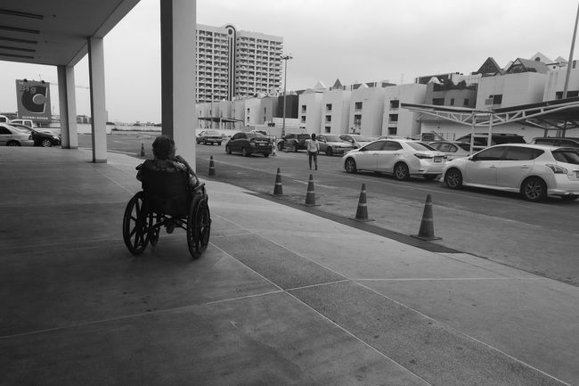 Weelchair Oldman Oldwoman Car Parking Looking Introspective Inattentive Vacant Abstract