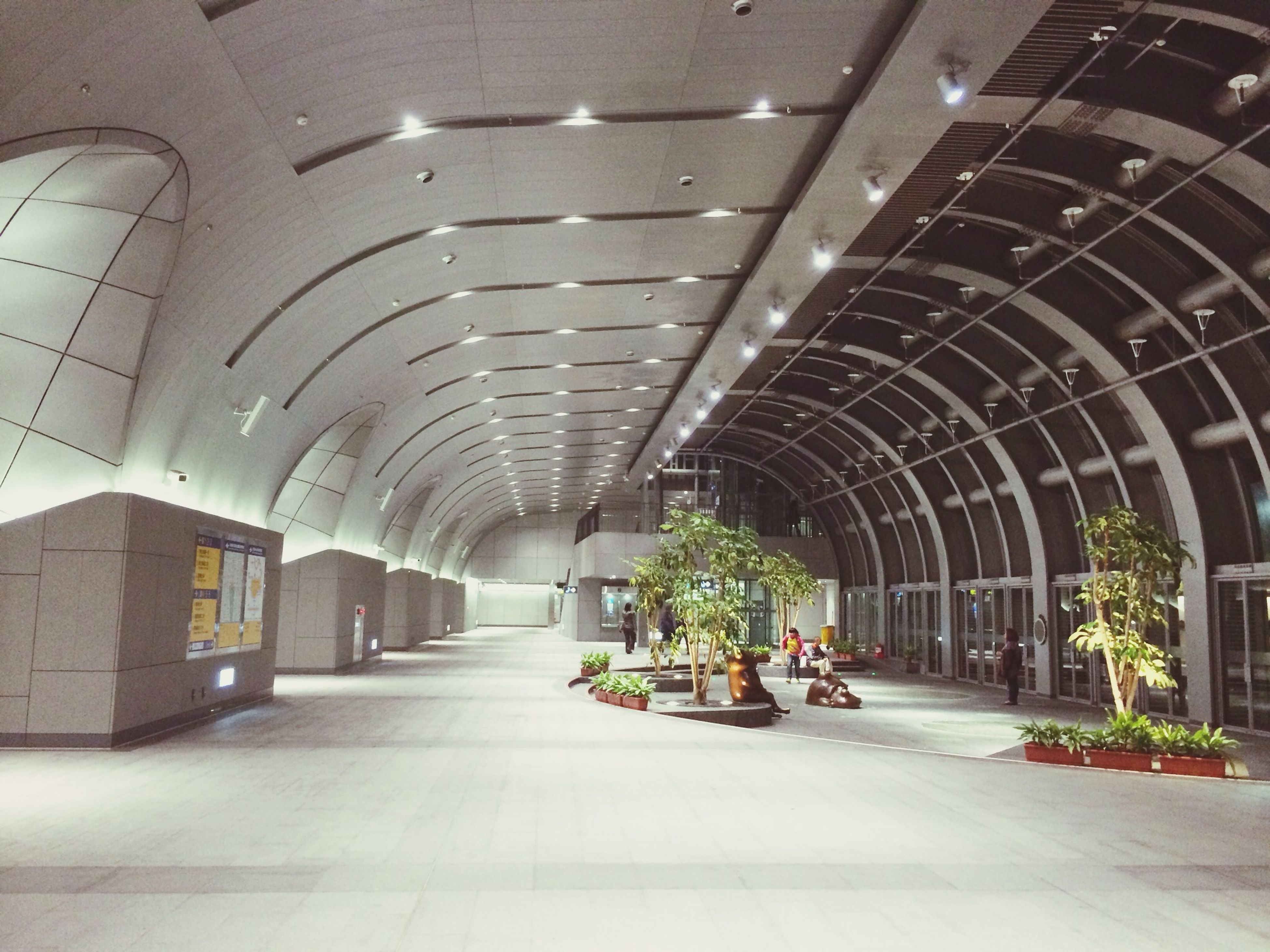 architecture, built structure, indoors, the way forward, arch, ceiling, diminishing perspective, incidental people, corridor, transportation, vanishing point, archway, architectural column, building, empty, building exterior, walkway, day, tunnel, tiled floor