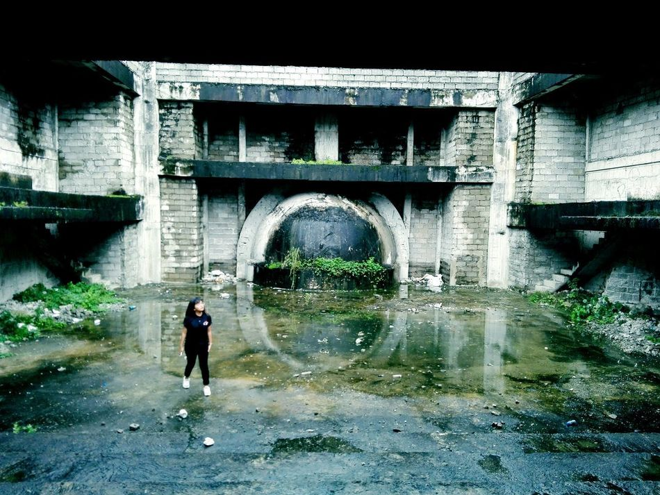 Bridge - Man Made Structure Connection Architecture Built Structure Below Water Arch Full Length Day Outdoors Under People One Person Adult Eyeem Philippines Break The Mold Abandoned Places Abandoned Buildings Abandonedbuilding Abandoned Abandonedplaces Abandonedplace Abandonedbuildings Abandonedschool