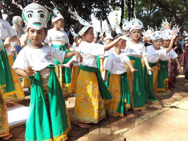 7). Facial Expressions Colosal Sunday Mass Traditional Culture Traditional Costume Kids Dance Cultural Dance On StreetGathering Observing People Jakarta, Indonesia Observing People
