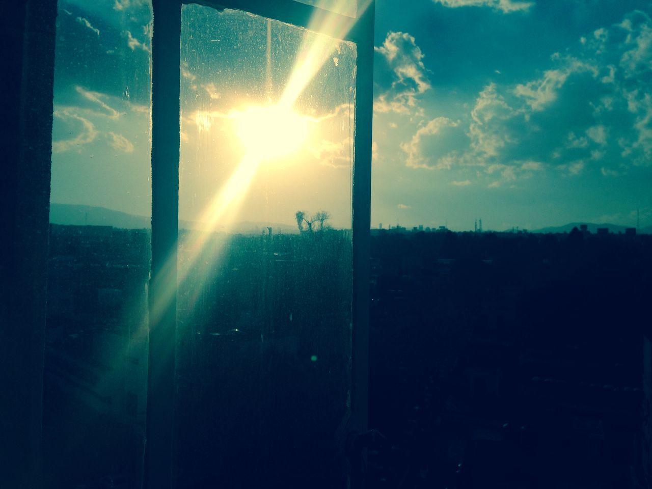Silhouette Landscape Against Sky Seen Through Glass Window