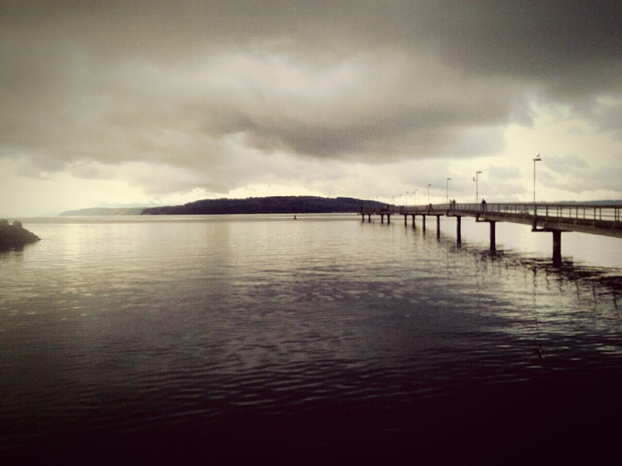 cloud - sky, sky, water, tranquility, outdoors, sea, nature, scenics, tranquil scene, no people, bridge, beauty in nature, architecture, day, storm cloud