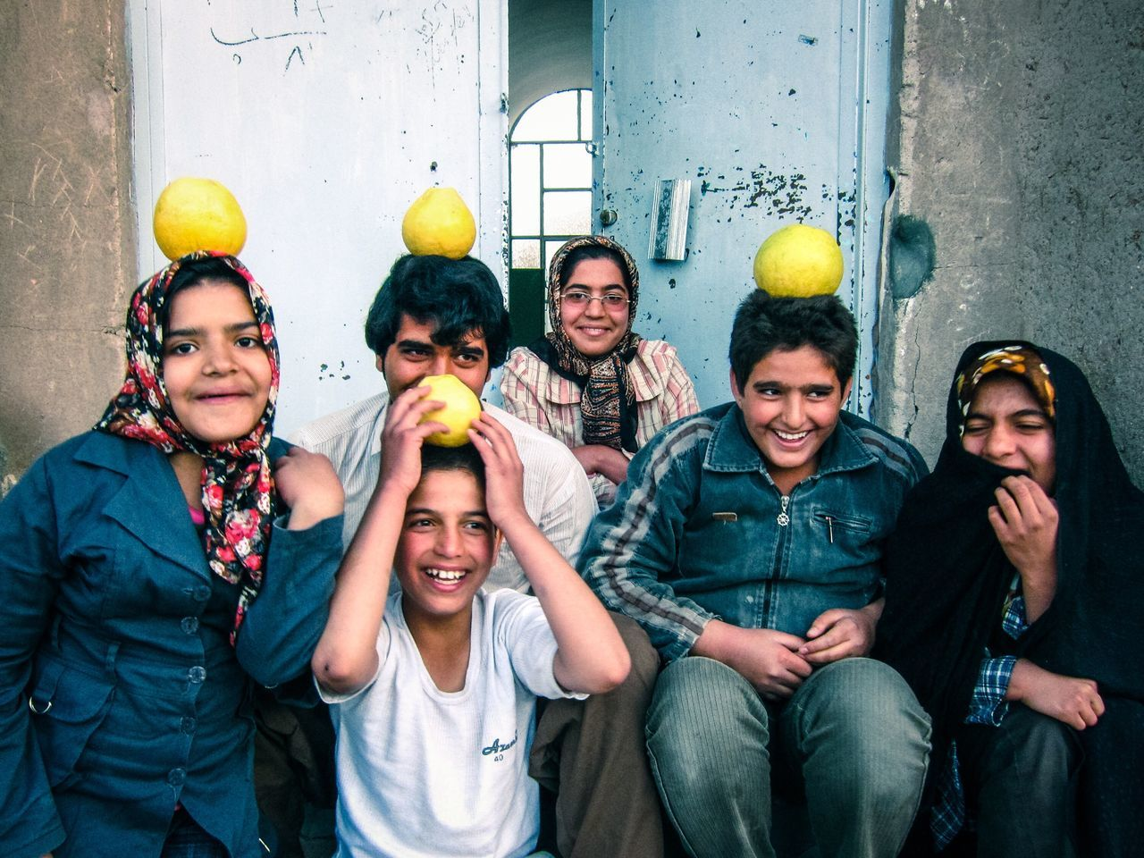 friendship, happiness, fun, young adult, group of people, togetherness, adult, men, cheerful, young men, people, multi colored, smiling, community, standing, real people, women, indoors, young women, portrait, balloon, party - social event, adults only, day, human hand
