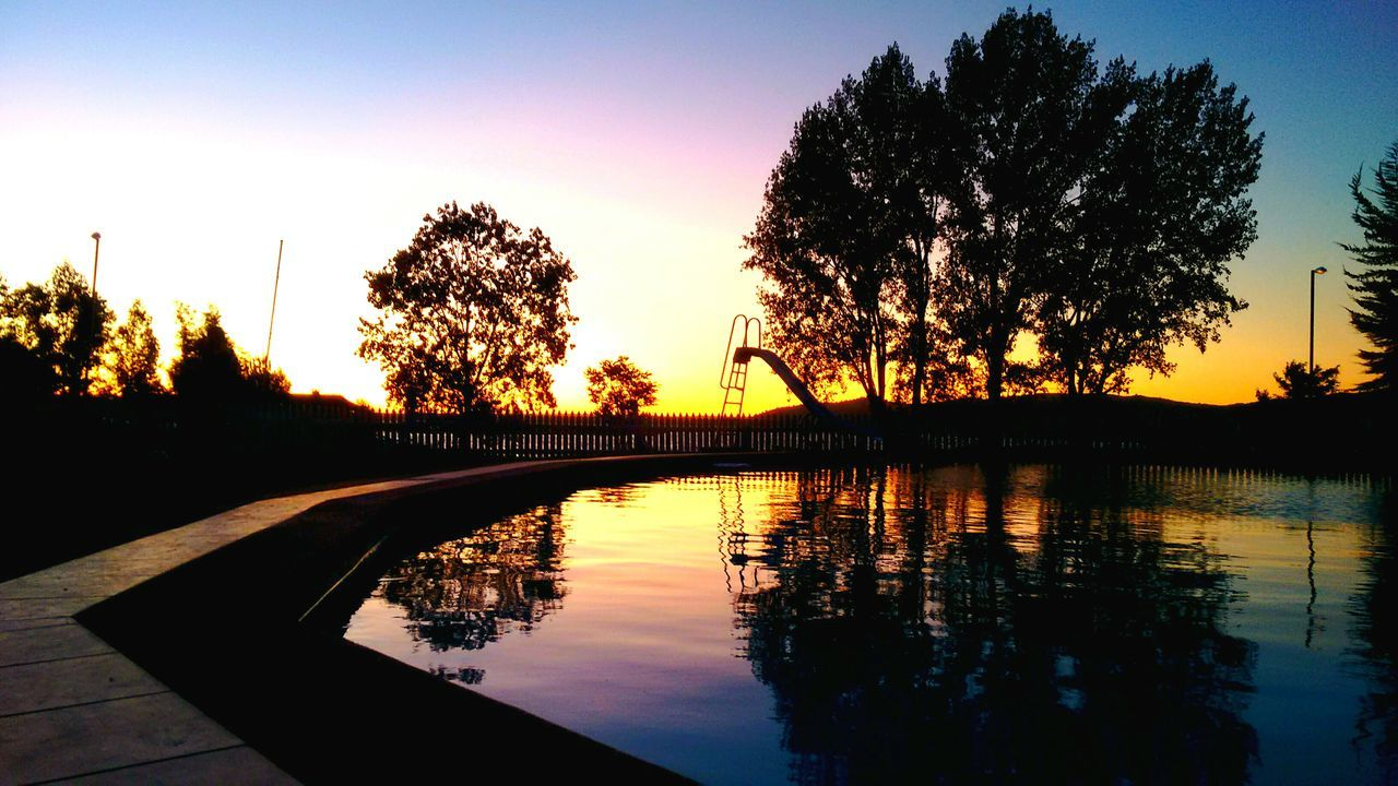 The OO Mission Chile Lights And Shadows Sunset Pool Water Reflections Sky Trees Trees And Sky Reflections Vintage Sunlight Lago Rapel Awesome EyeEm Best Shots