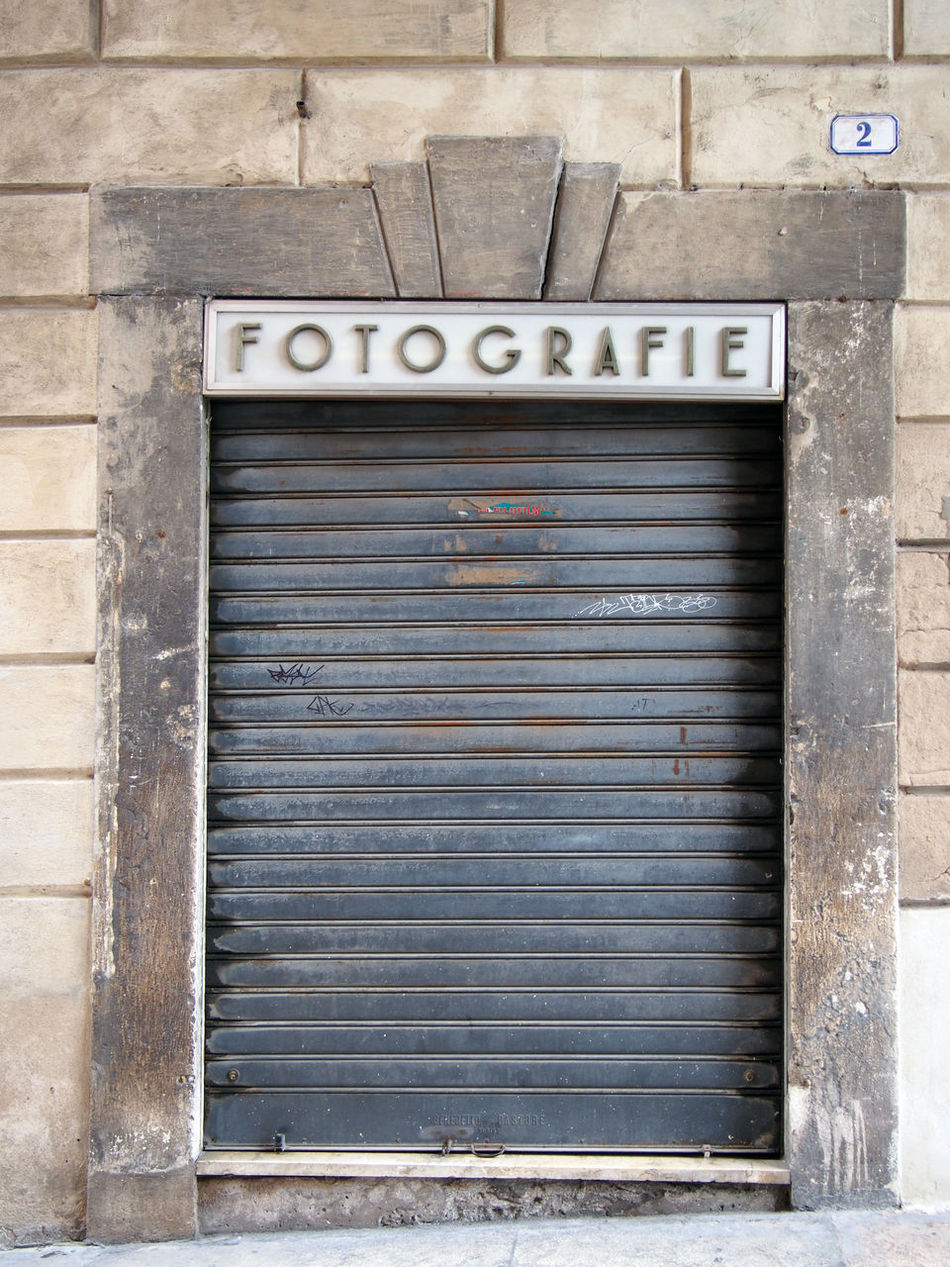 no photography Architecture Building Exterior Built Structure Close-up Closed Day No Parking Sign No People Outdoors Shop Shutter Vintage