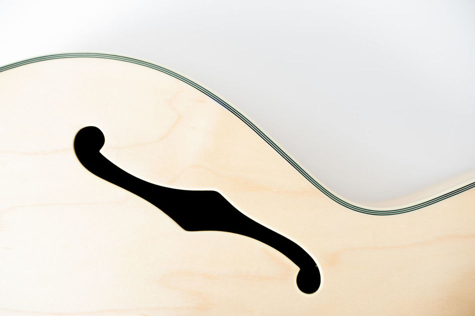 Electric guitar part detail Body Part Chords Close Up Close-up Detail Electric Guitar Equipment F-hole Guitar Jazz Music Musical Instrument No People Rock Sign Sound Stringed Symbol White Background