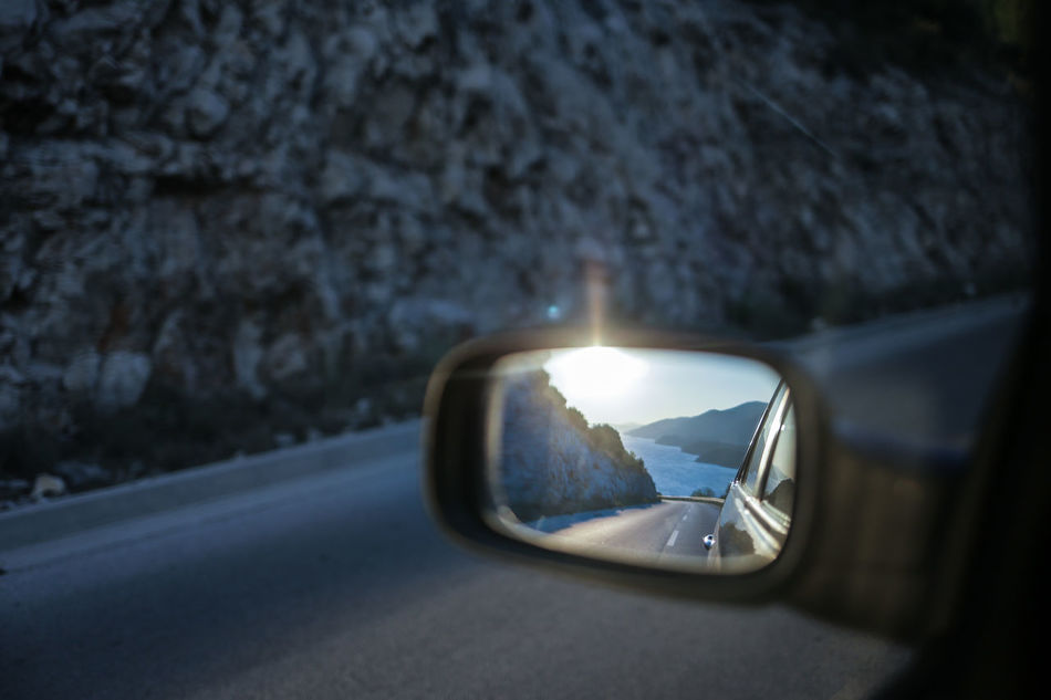 On the road at Peljesac peninsula in Southern Dalmatia, Croatia Adriatic Car Close-up Croatia Dalmatia Day Driving Journey Land Vehicle Mode Of Transport Mountains Nature No People Outdoors Peljesac Reflection Reflection Road Road Trip Side-view Mirror Sunset The Drive Transportation Travel Photography Vehicle Mirror