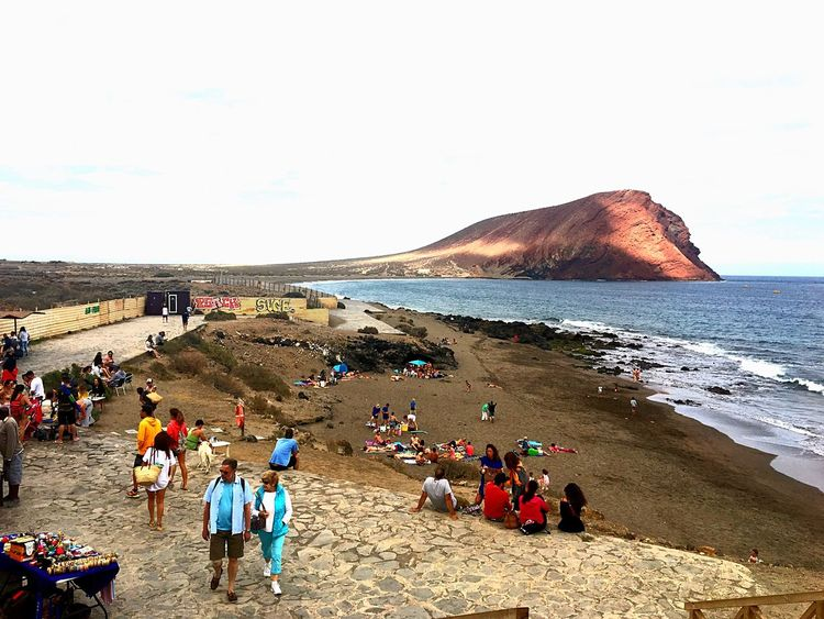 Live For The Story Large Group Of People Sea Beach Leisure Activity Volcanic Landscape Women Day Outdoors Sky Vacations Men Clear Sky Nature Lifestyles People Real People Adult Water Travel Destinations Sunlight EyeEmNewHere