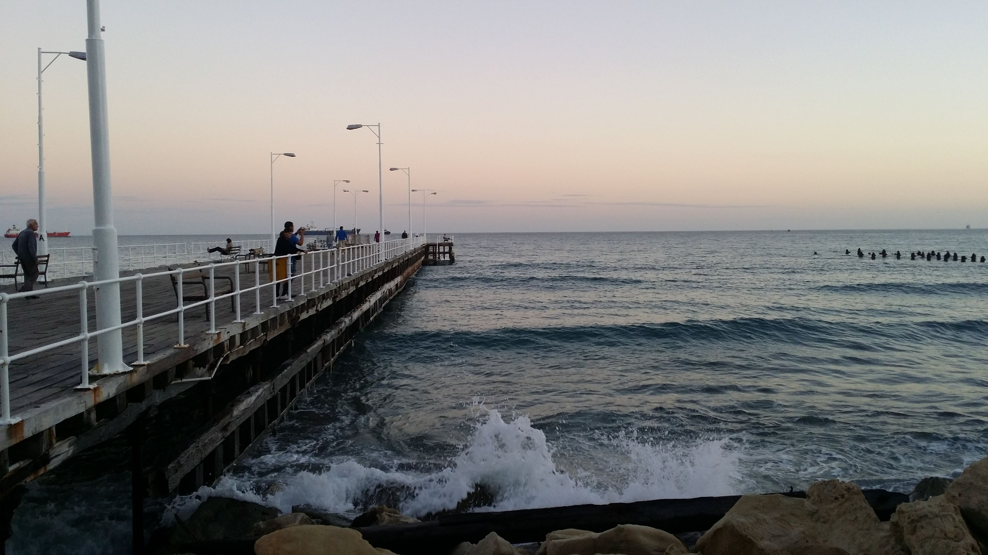 sea, water, horizon over water, scenics, tranquil scene, beauty in nature, pier, tranquility, wave, sky, nature, railing, beach, sunset, clear sky, idyllic, copy space, shore, surf, remote