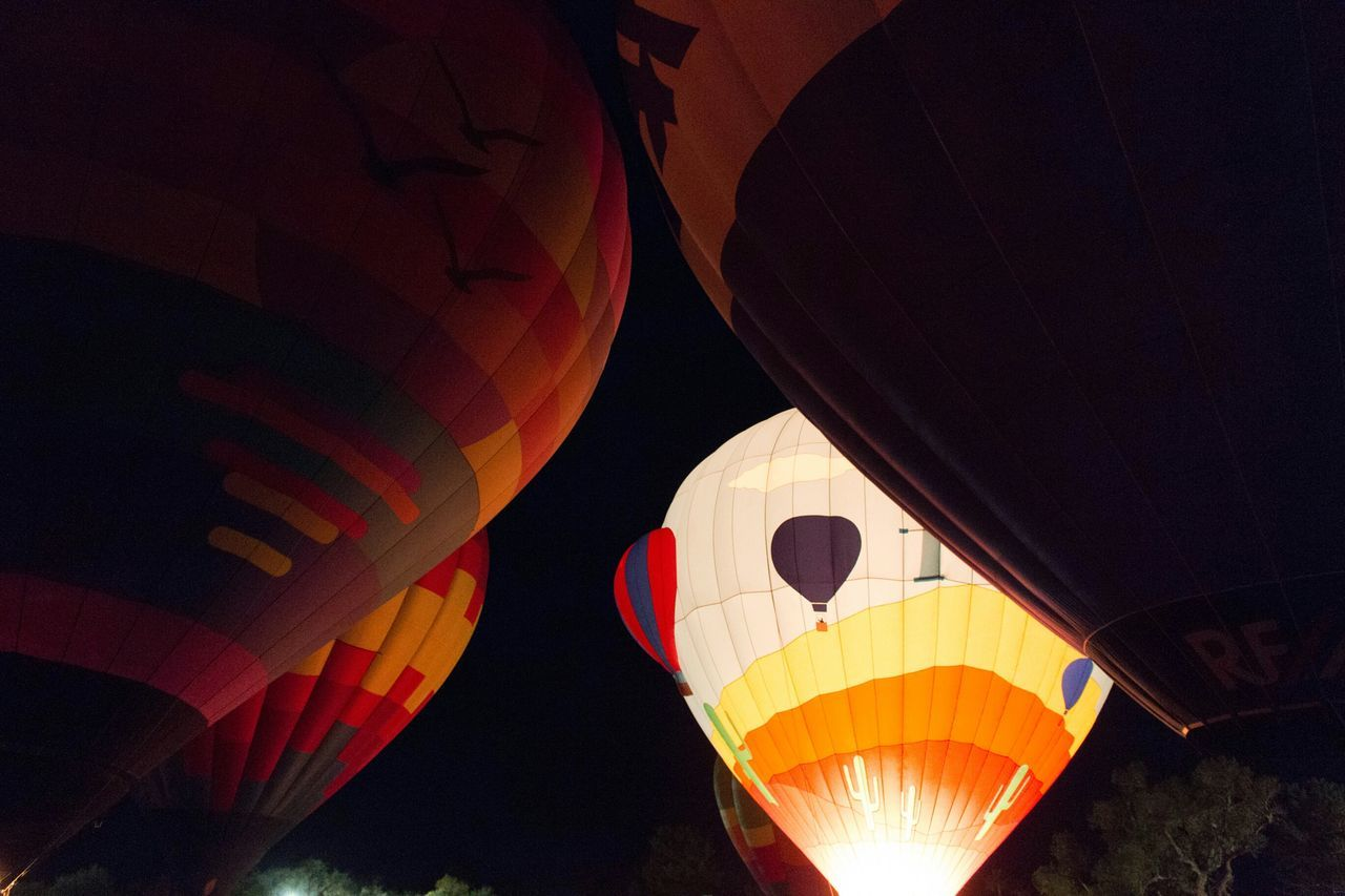 All lined up and ready to go. Winterfest Preparation  Hotairballoons Upcloseandpersonal Tucson Az Liftoff Capture The Moment Outdoor Photography Thephotographer Upupandaway Adventures Eye4photography  Arizona Tubac Myperspective Photography Nightphotography Festival Fire In The Sky All Lined Up In A Row Ready To Go Bottomview Stillness Artistsmind Anticipation