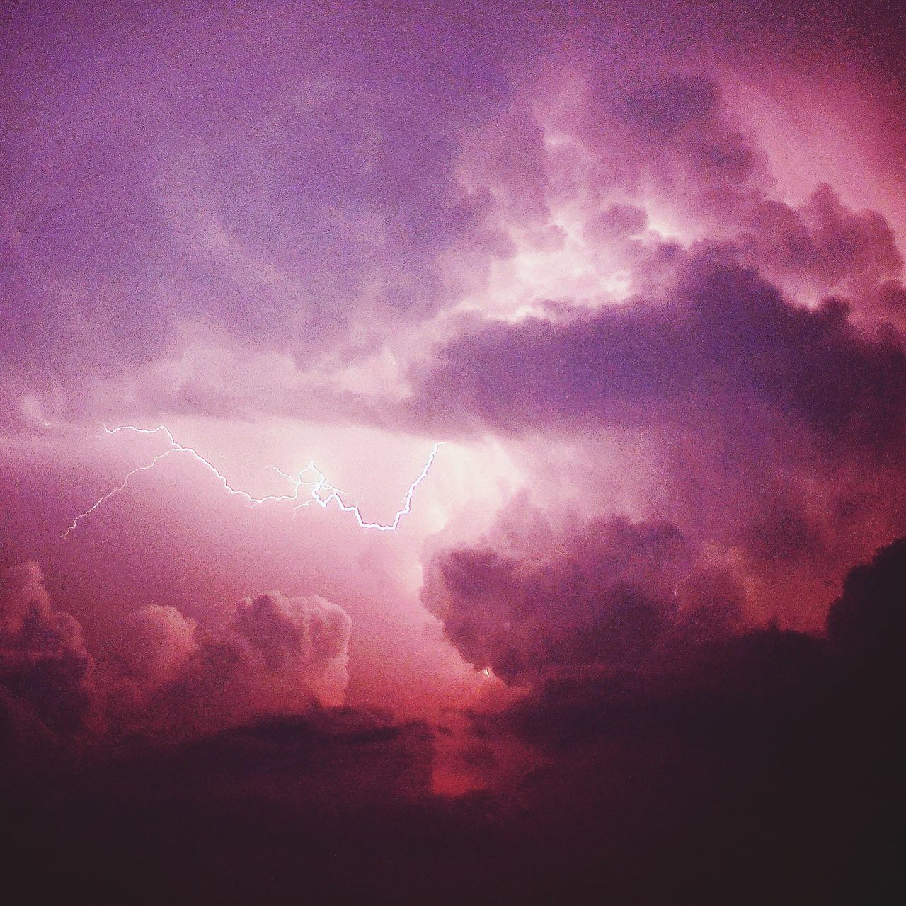 Low Angle View Of Lightning In Cloudy Sky During Stormy Weather