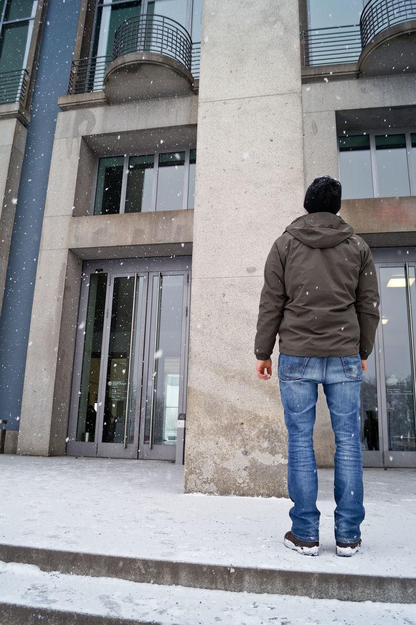building exterior, built structure, architecture, rear view, one person, full length, real people, men, day, lifestyles, outdoors, standing, warm clothing, one man only, people