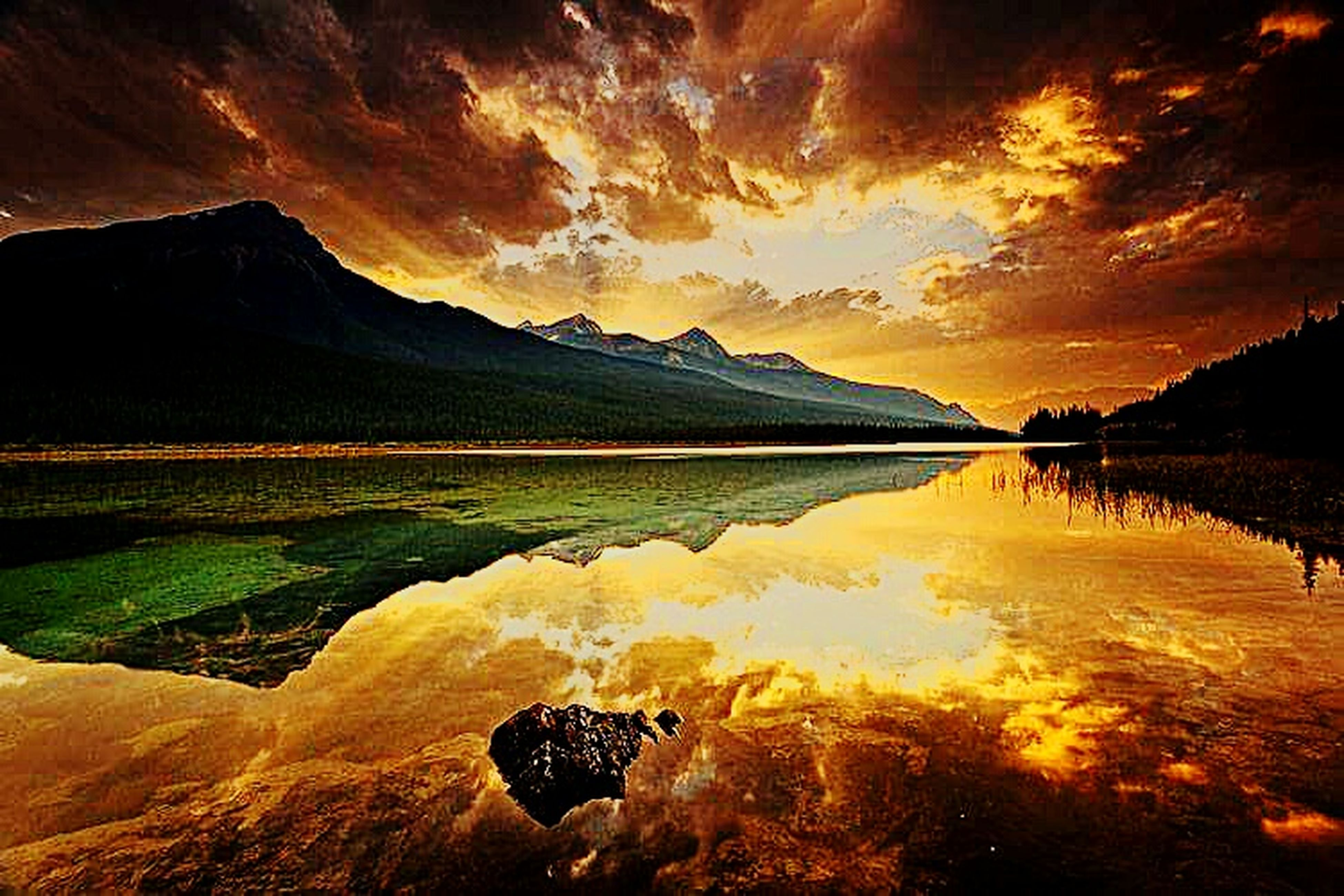 reflection, mountain, landscape, beauty in nature, lake, sunset, nature, mountain range, scenics, awe, sunlight, outdoors, rock - object, no people, water, sky, day