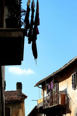 Hanging Clothesline Drying Architecture Sky Built Structure Building Exterior Day Outdoors No People Sun Idyllic