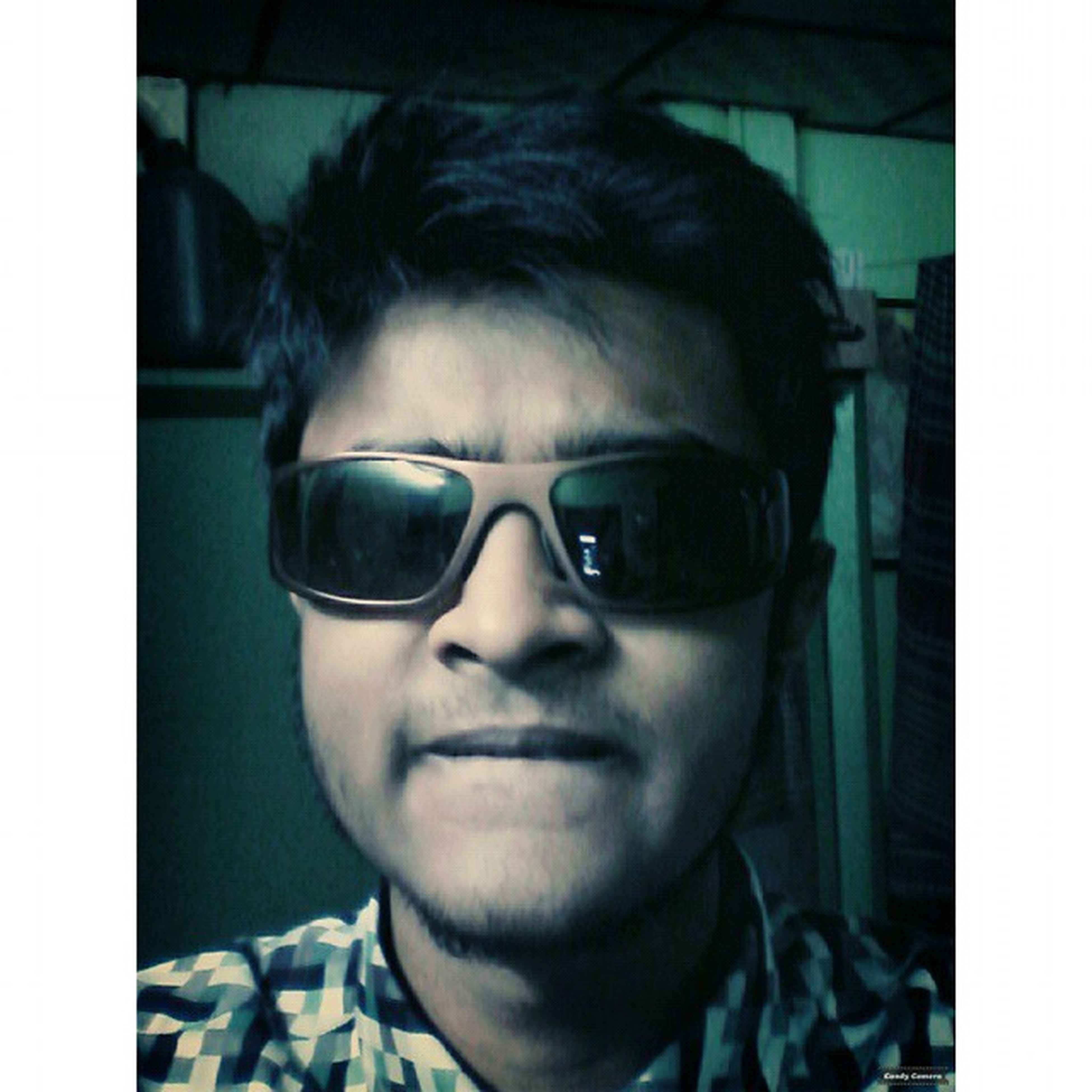 transfer print, looking at camera, portrait, person, auto post production filter, headshot, lifestyles, head and shoulders, young adult, indoors, front view, leisure activity, close-up, sunglasses, young men, smiling, mid adult, human face