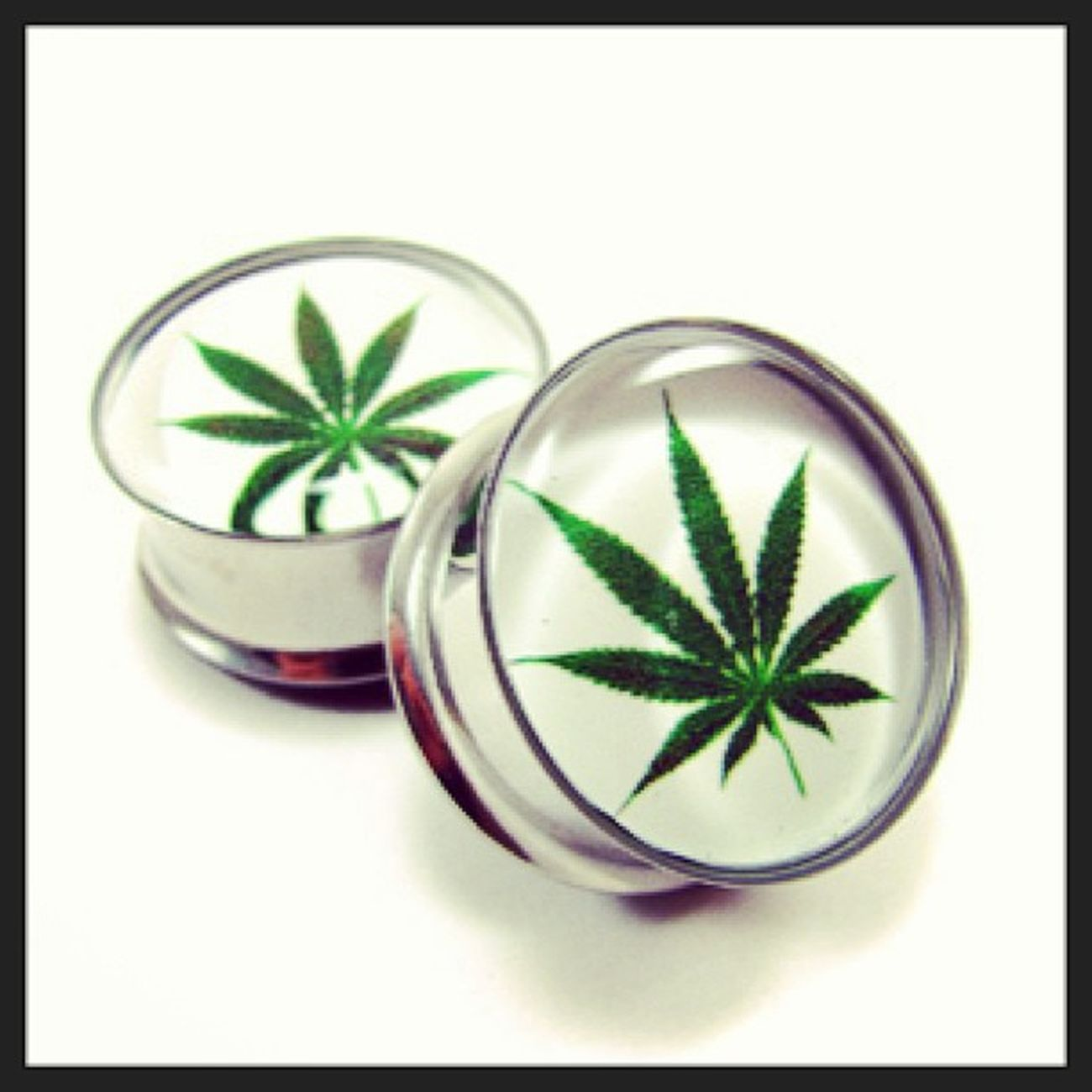 I would love to have these! Tapers Plugs Stretched Ears stretching weed potleaf pot glass green marijuana maryj killer awesome love to have stretching gauges tunnels