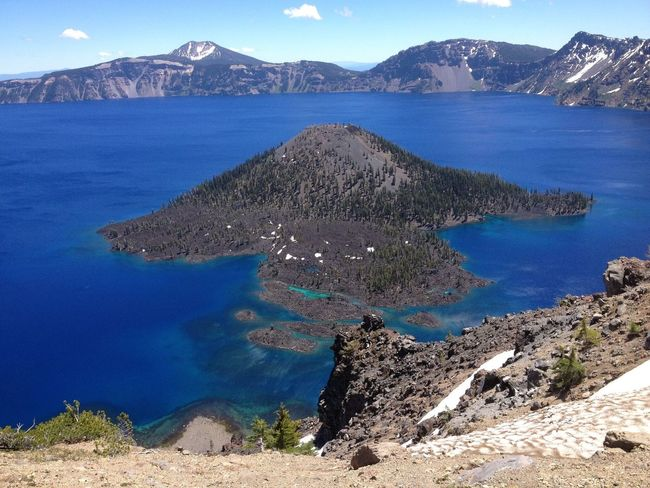 Beauty In Nature Blue Crater Lake National Park Day Geology Idyllic Landscape Majestic Mountain Mountain Range Nature No People Non-urban Scene Outdoors Physical Geography Remote Rock - Object Rock Formation Scenics Sky Tourism Tranquil Scene Tranquility Travel Destinations Water