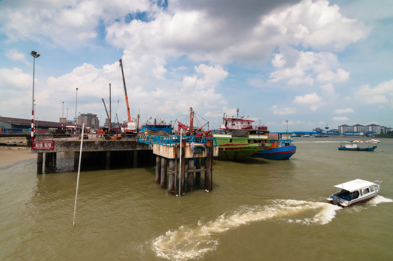 nautical vessel, transportation, mode of transport, cloud - sky, sky, water, day, waterfront, sea, freight transportation, no people, outdoors, shipping, moored, architecture, nature