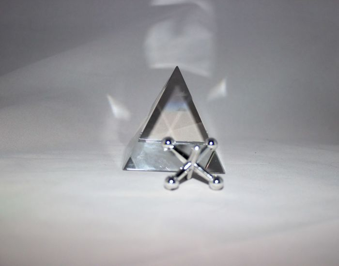 Jacks with crystal pyramid Childhood Close-up Crystal Day Indoors  Jacks No People Pyramid Silver