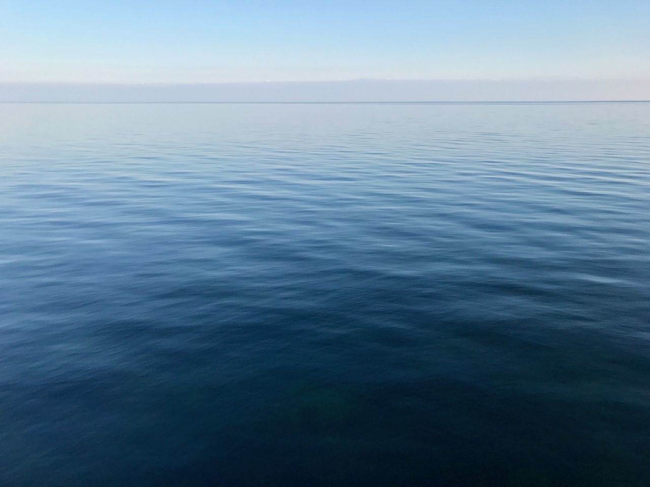 Beauty In Nature Blue Clear Sky Day Horizon Over Water Monochrome Nature No People Ocean Outdoors Rippled Scenics Sea Sky Tranquil Scene Tranquility Water