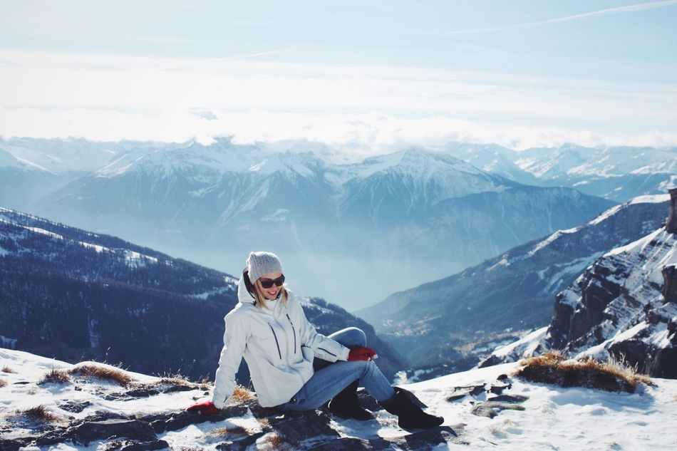 Snow Mountain Cold Temperature Winter Season  Tranquil Scene Sitting Mountain Range Scenics Leisure Activity Beauty In Nature Tranquility Tourism Snowcapped Mountain Weather Tourist Lifestyles Full Length White Color Non-urban Scene