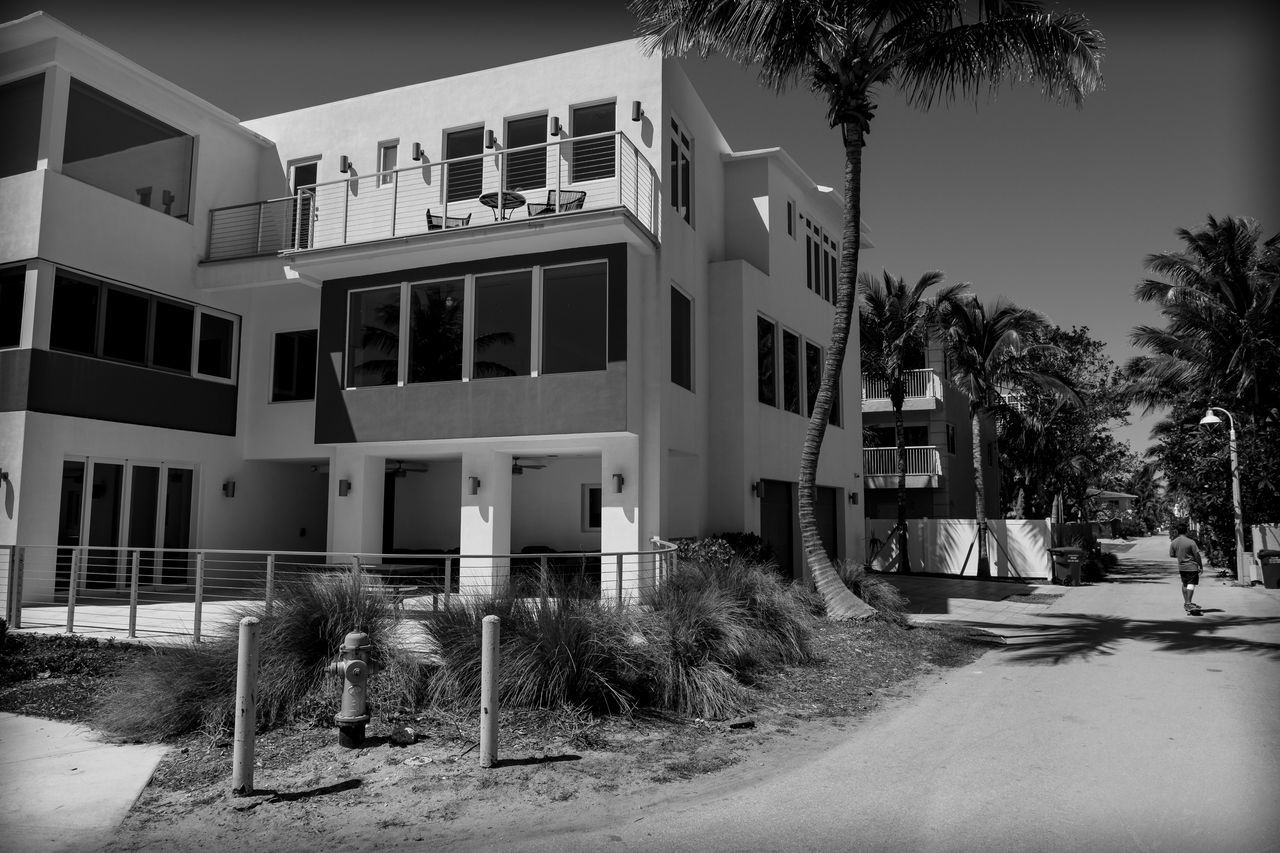 Living Well Architecture Blackandwhite Photography Building Exterior Built Structure Contemporary Day Florida Life Fujifilm_xseries Lifestyle Modern Modern Architecture No People One Person Outdoors Palm Tree Photographyisthemuse Quiet Places Skateboarding Sunny Tree Warm Wealth White Color