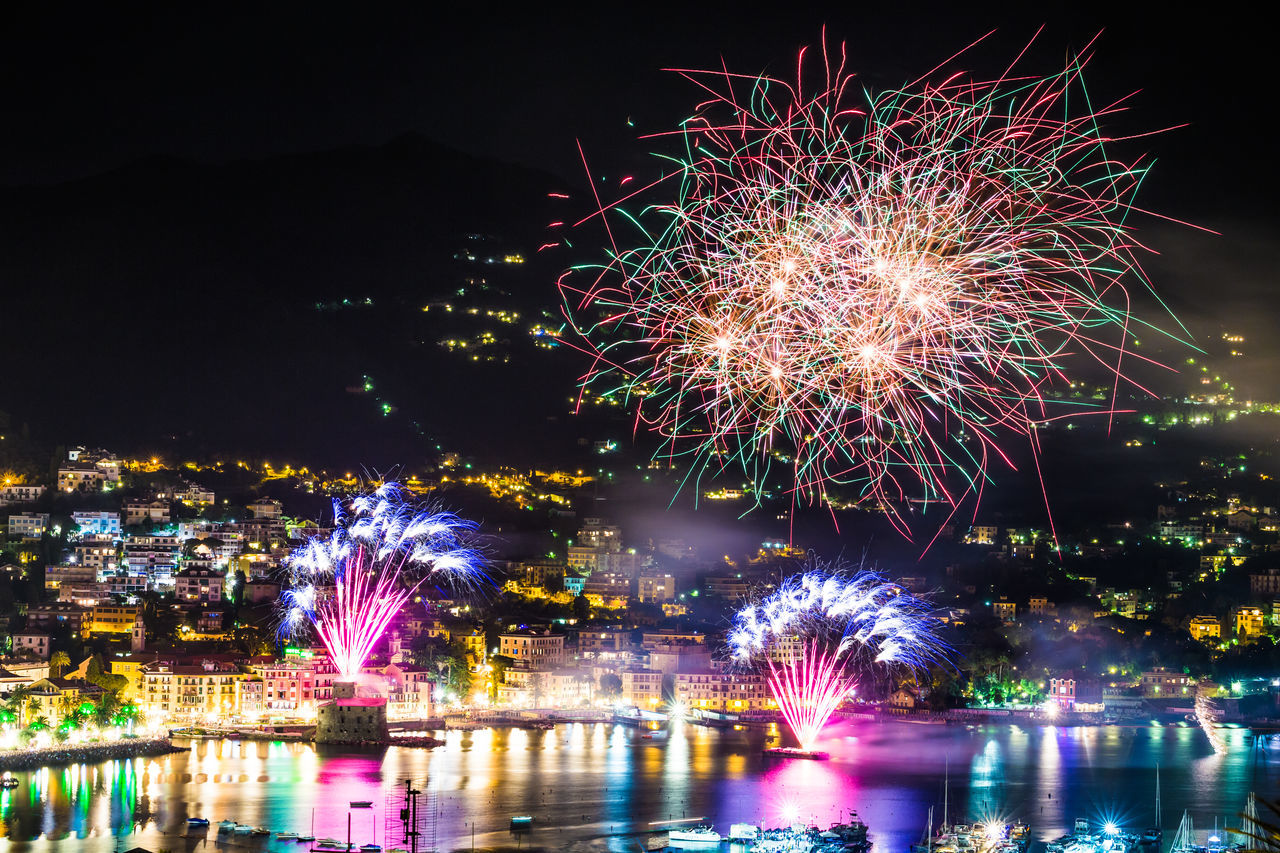 Annual Event Celebration Celebration Event City Cityscape Event Exploding Firework - Man Made Object Firework Display Holiday - Event Illuminated Liguria,Italy Midnight Multi Colored New Year's Eve Night No People Outdoors Party - Social Event Reflection River Sky Travel Destinations Water