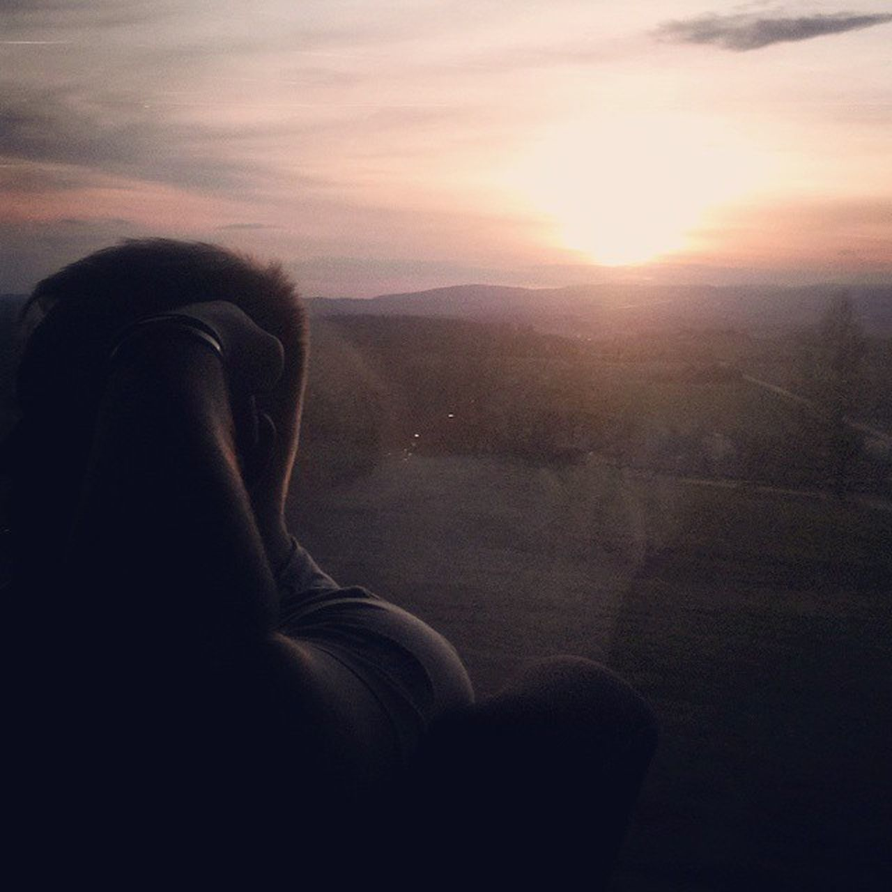 sunset, real people, rear view, one person, sitting, lifestyles, women, nature, sky, indoors, day, people