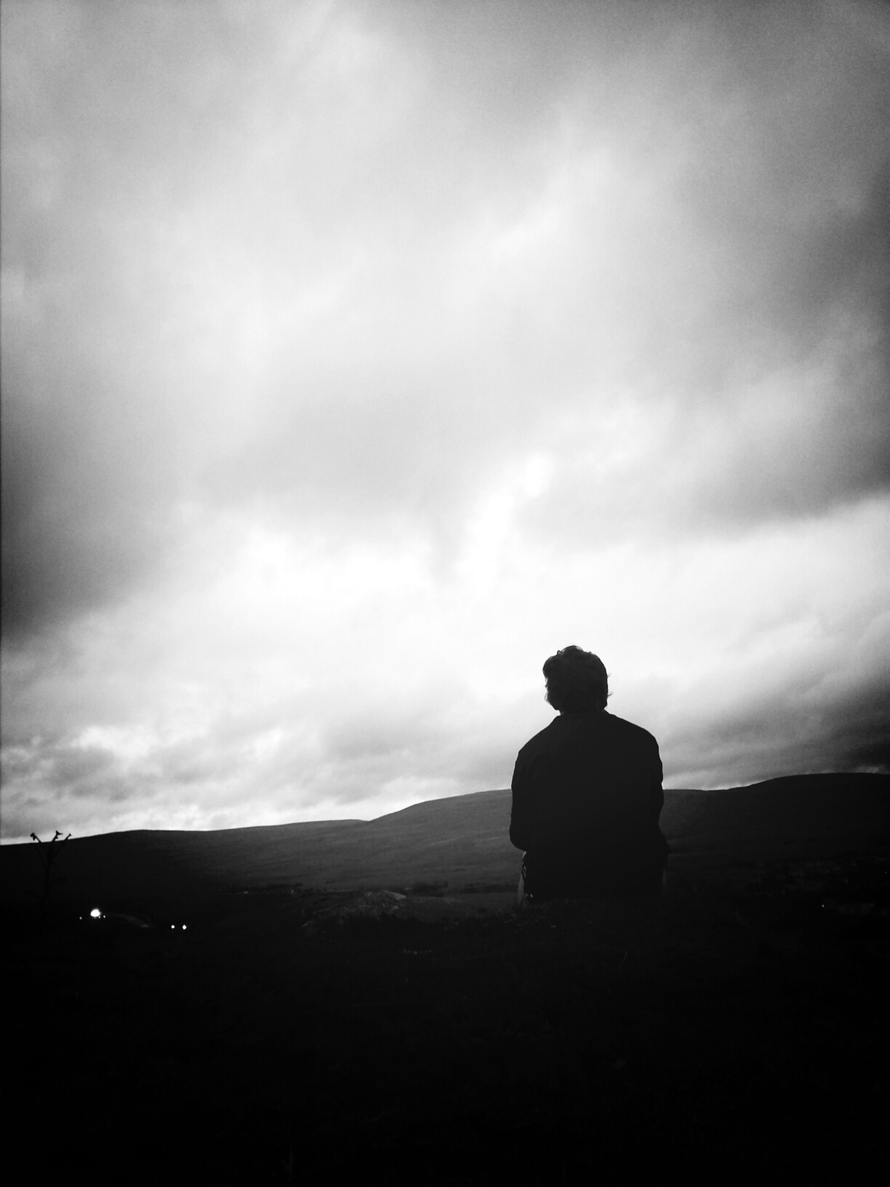 sky, rear view, cloud - sky, men, lifestyles, standing, tranquility, landscape, leisure activity, tranquil scene, silhouette, full length, cloudy, nature, looking at view, cloud, scenics, mountain