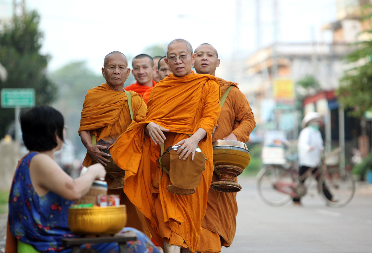 religion, real people, shaved head, men, boys, focus on foreground, cultures, spirituality, outdoors, tradition, yellow, togetherness, day, young adult, adult, people