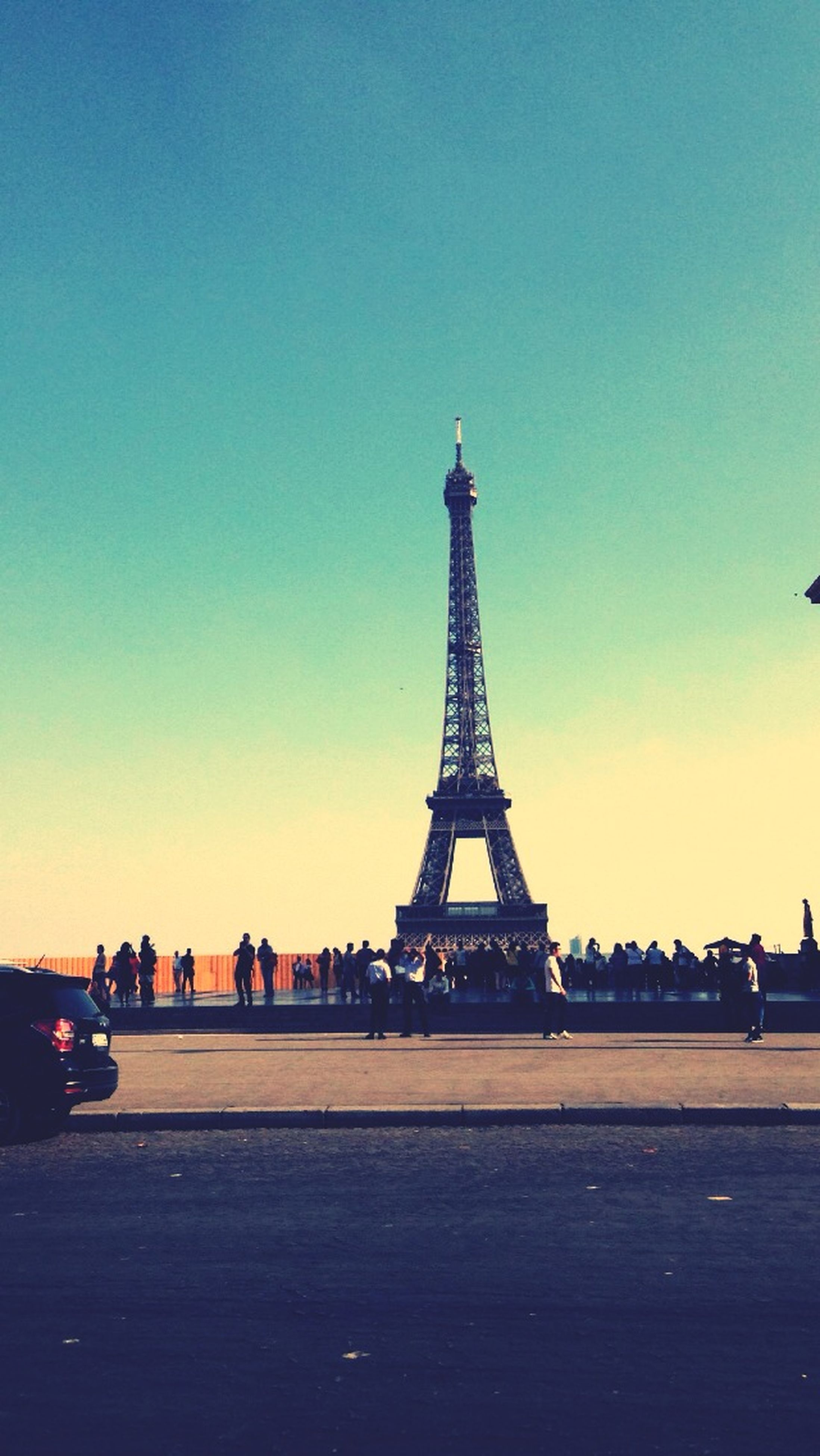 clear sky, copy space, eiffel tower, built structure, architecture, international landmark, famous place, travel destinations, transportation, travel, metal, capital cities, tower, tourism, tall - high, sunset, culture, outdoors, sky, dusk