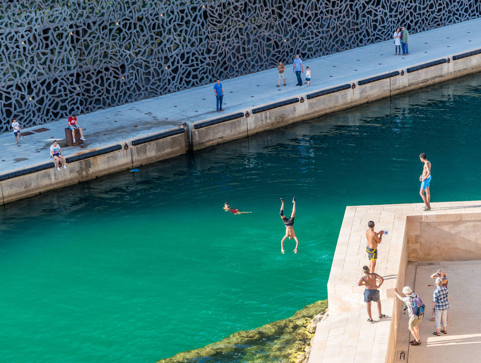 Day Enjoyment Full Length Fun Jumping Leisure Activity Lifestyles Marseille Marseillecartepostale Men Motion MUCEEM Outdoors Real People Recreational Pursuit Side View Togetherness Vacations Water Weekend Activities A Bird's Eye View Up Close Street Photography Telling Stories Differently Alternative Fitness People Of The Oceans
