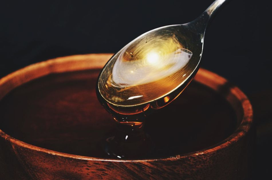 Spoon full of honey dripping into wooden bowl Honey Wooden Bowl Sweet Sugar Golden Amber Pure Natural Pure Honey Organic Medicine Remedies Home Remedies Natural Honey Dripping Honey Spoon Full Spoon Silver Spoon Wooden