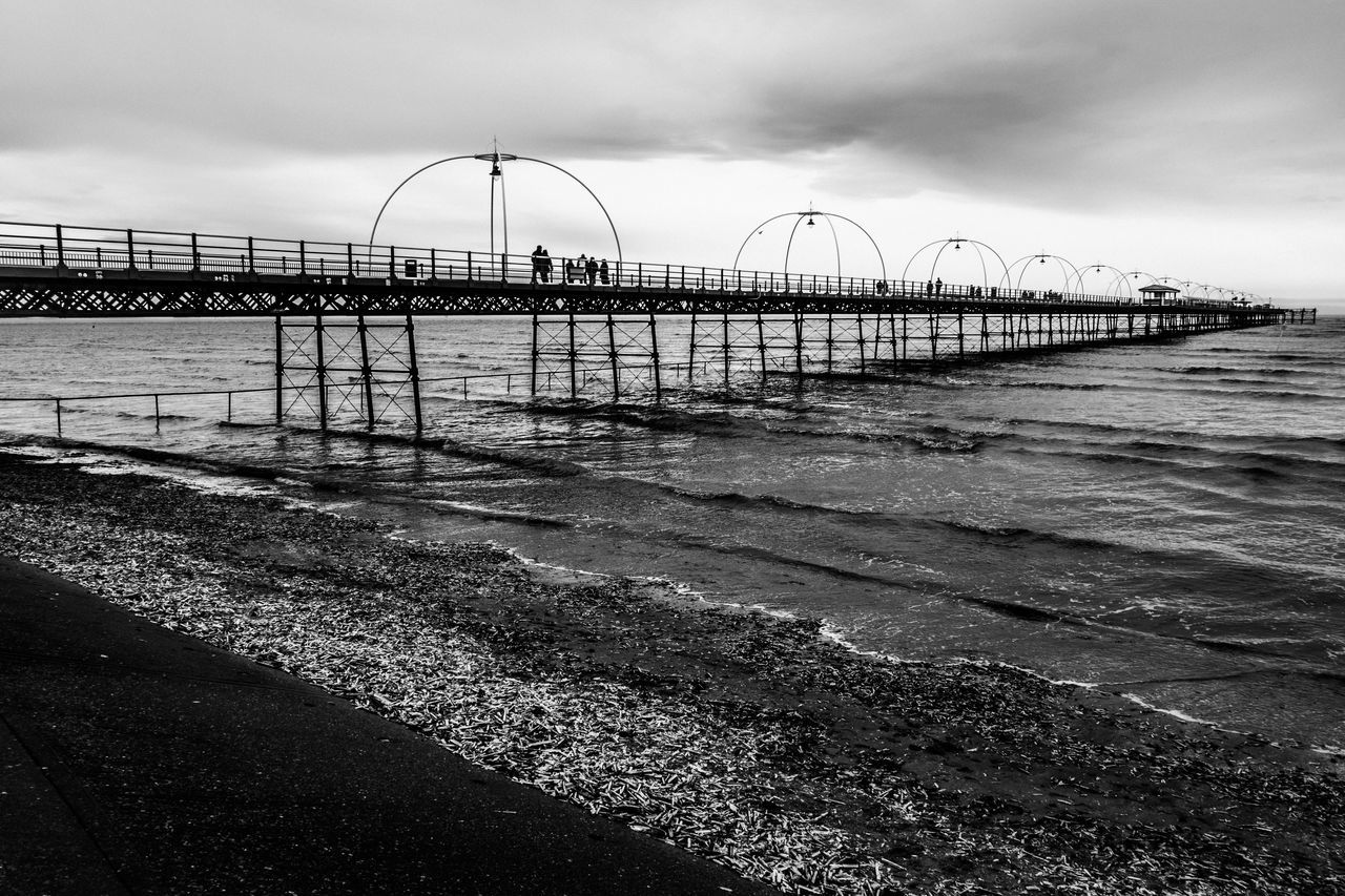 pier silhouette Beach Black And Wh Engineering Full Length Horizon Over Water Incidental People Leading Outdoors Pier Sand Sea Shore Southport Southport Pi Structure The Way Forward Vacations Walking Water Wave