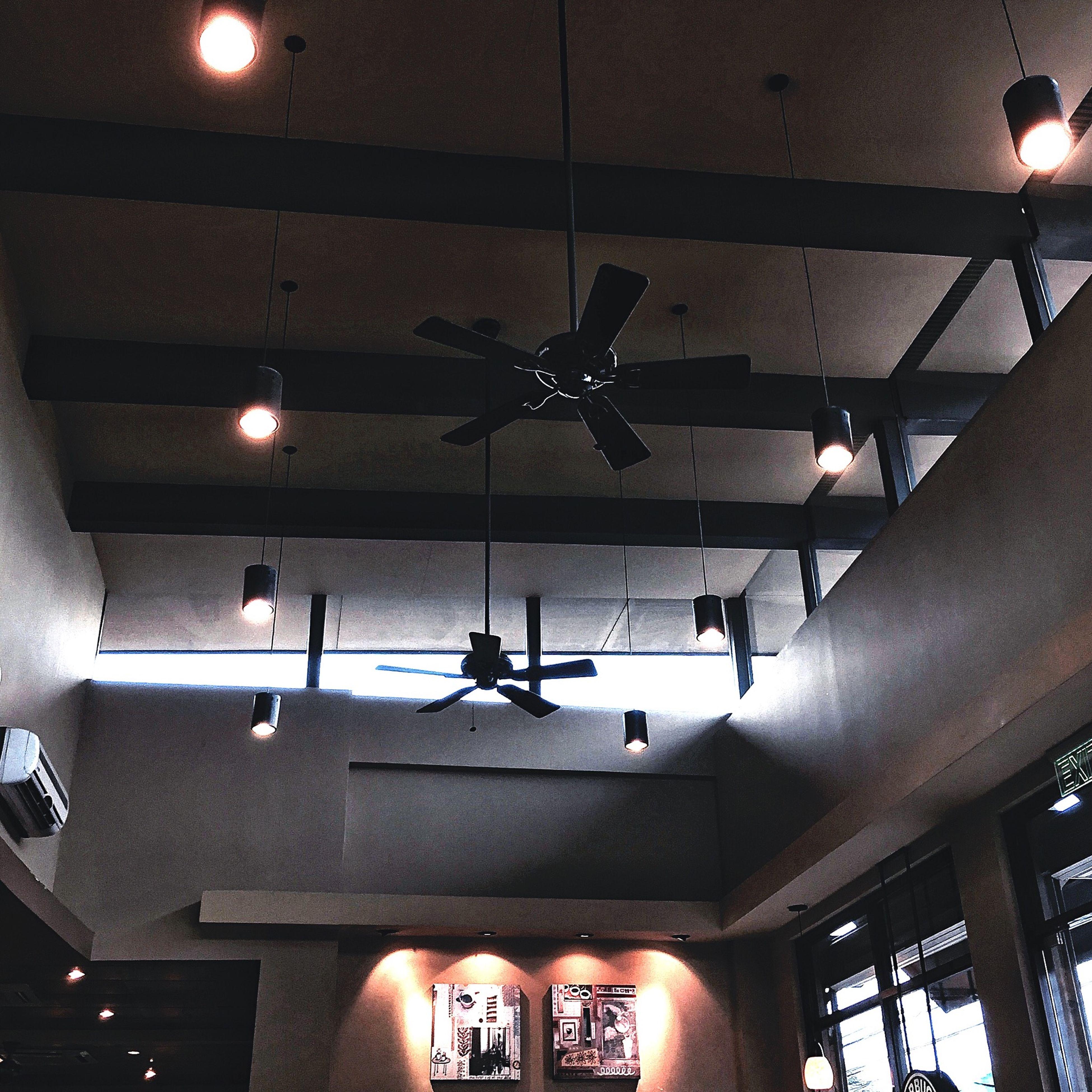 indoors, illuminated, lighting equipment, ceiling, low angle view, hanging, electricity, architecture, electric lamp, electric light, built structure, light bulb, lamp, night, light - natural phenomenon, technology, lantern, pendant light, lit, light fixture
