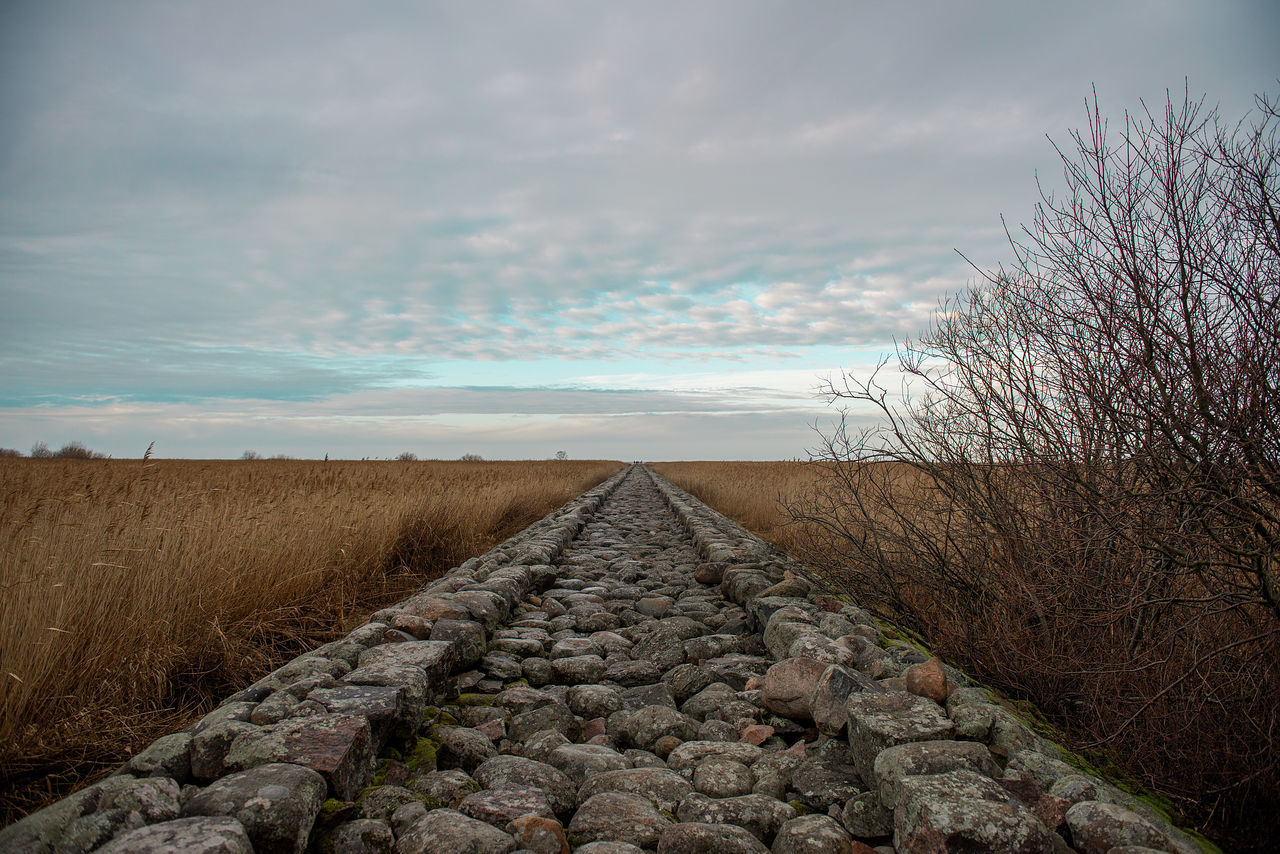 Cloud - Sky Day Green Sky Latvia Nature No People Outdoors Road Road To The Sea Road Trip Rock Rock Background Stone Jetty Stone Path Tourism Tourist Trail Vintage Miles Away
