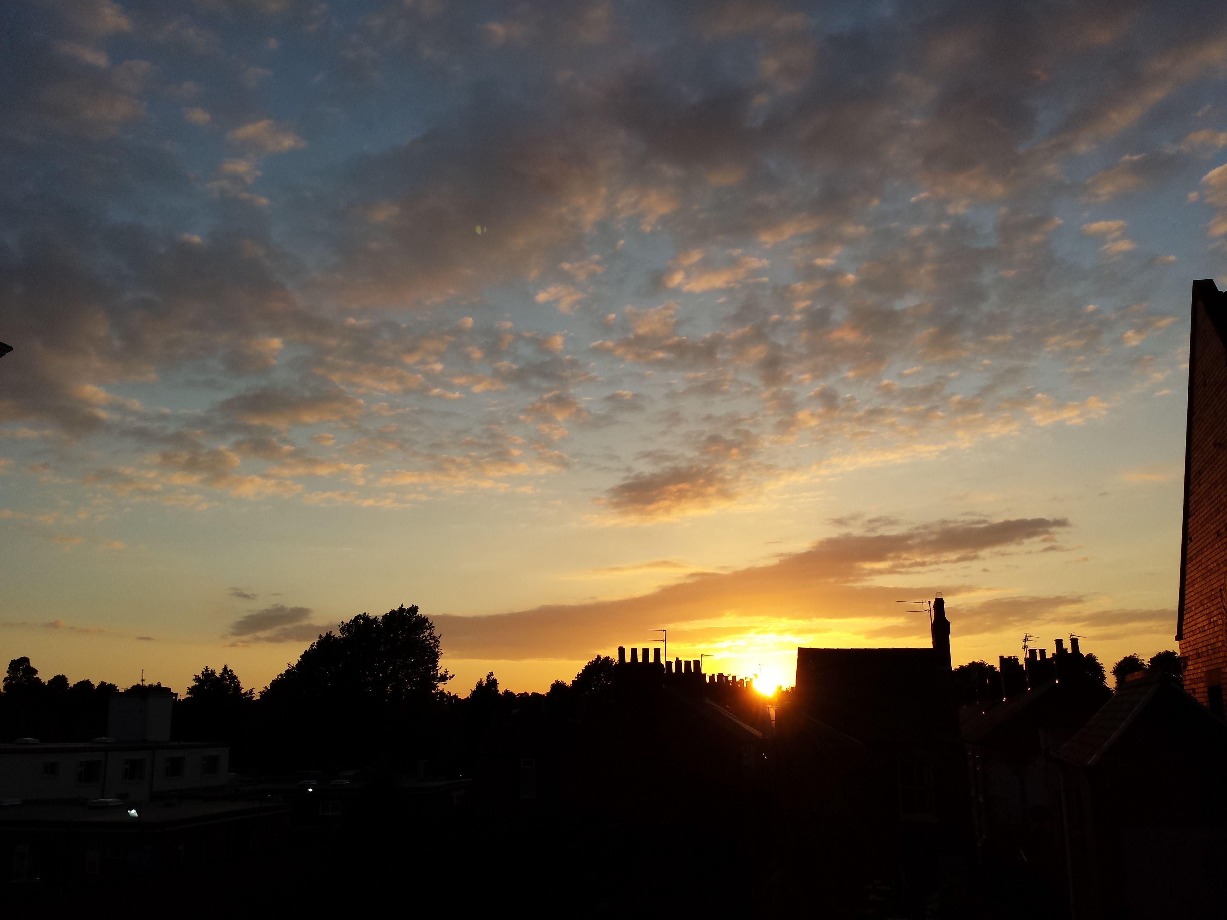 sunset, silhouette, sky, orange color, building exterior, cloud - sky, built structure, architecture, beauty in nature, scenics, sun, nature, cloud, house, tranquil scene, tree, tranquility, dramatic sky, idyllic, sunlight