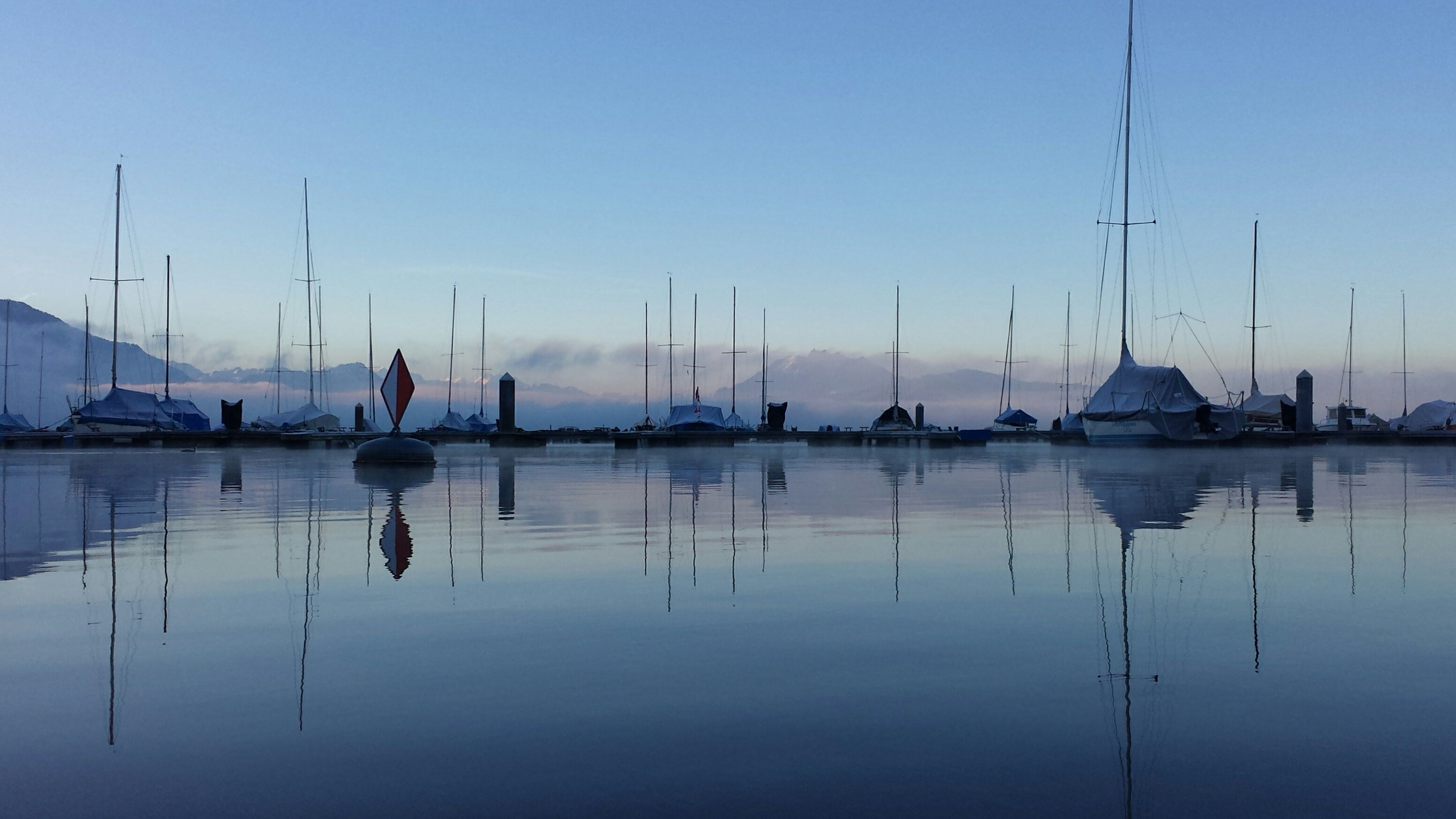nautical vessel, water, transportation, boat, moored, mode of transport, mast, reflection, sailboat, sea, waterfront, harbor, clear sky, sky, tranquil scene, tranquility, nature, scenics, blue, lake