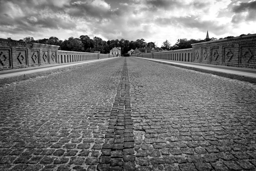 Old bridge over the river with pavement. Architecture Building Exterior Built Structure Cloud - Sky Cobblestone Day History Kuldiga Latvia Nature No People Outdoors Sky The Way Forward Tree