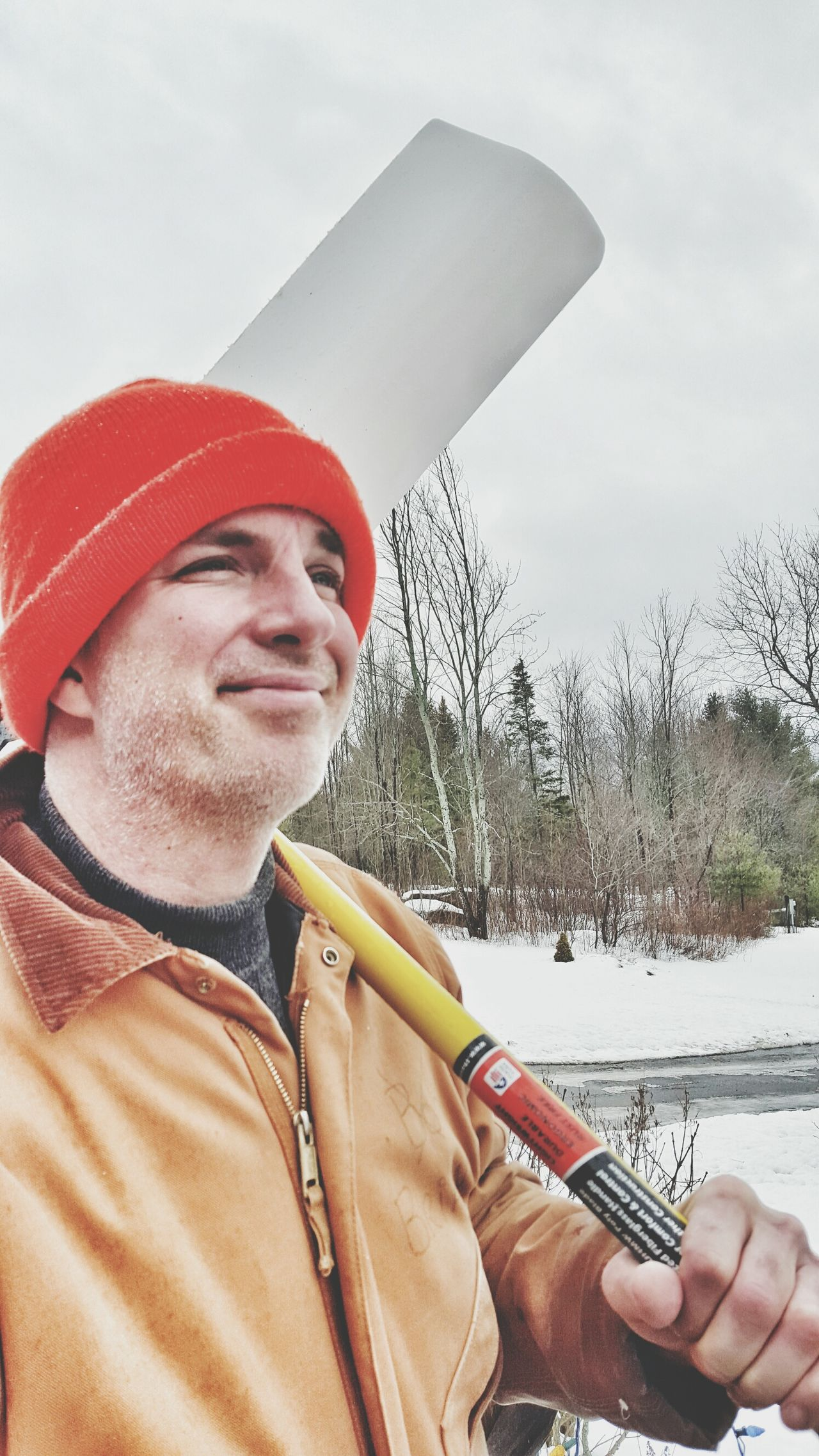 Smiling plow guy with big snow shovel to clear ice and snow in upstate New York. Shoveling Snow Plow Guy Smiling Work Ethics Copy Space Hard Work Wintertime Man At Work Work Suit Adirondacks Snow And Ice  Snow In Background Orange Hat Unshaved Cold Weather Overcast Candid Real People Man Side Profile Working Looking Up Close-up Plowing The Snow Ski Cap
